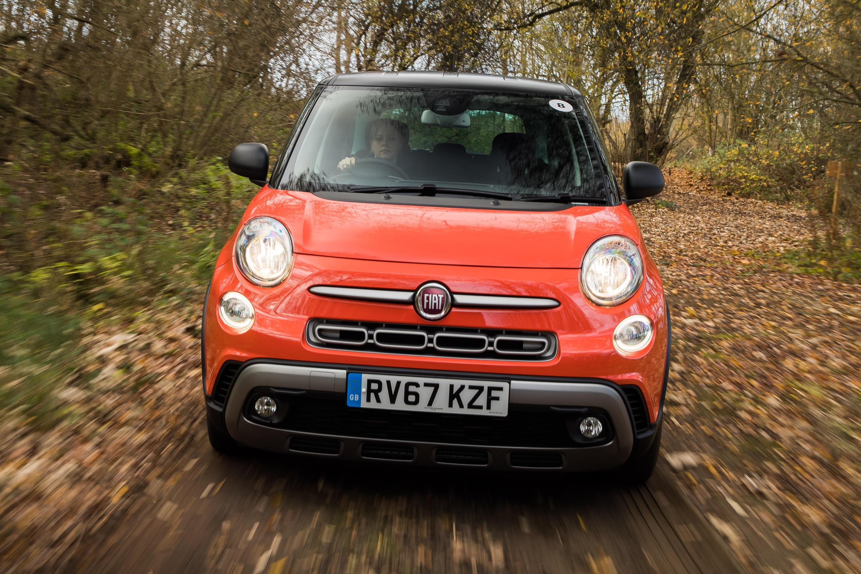 Orange FIAT 500L driving towards you in the middle of the woods