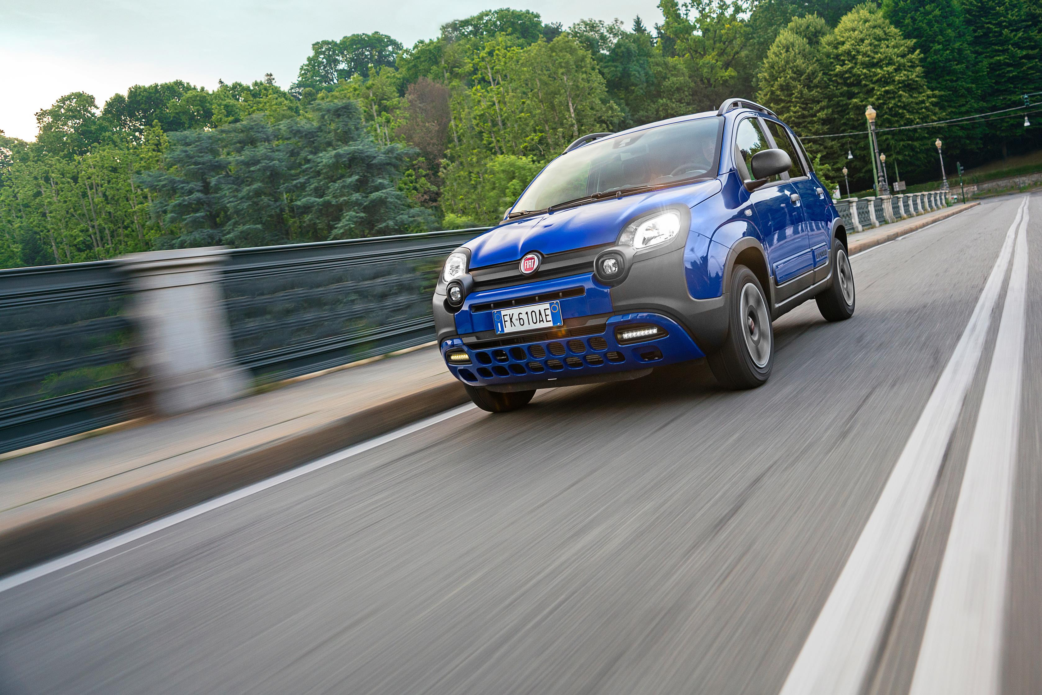 Royal Blue Fiat Panda City Cross crossing a bridge