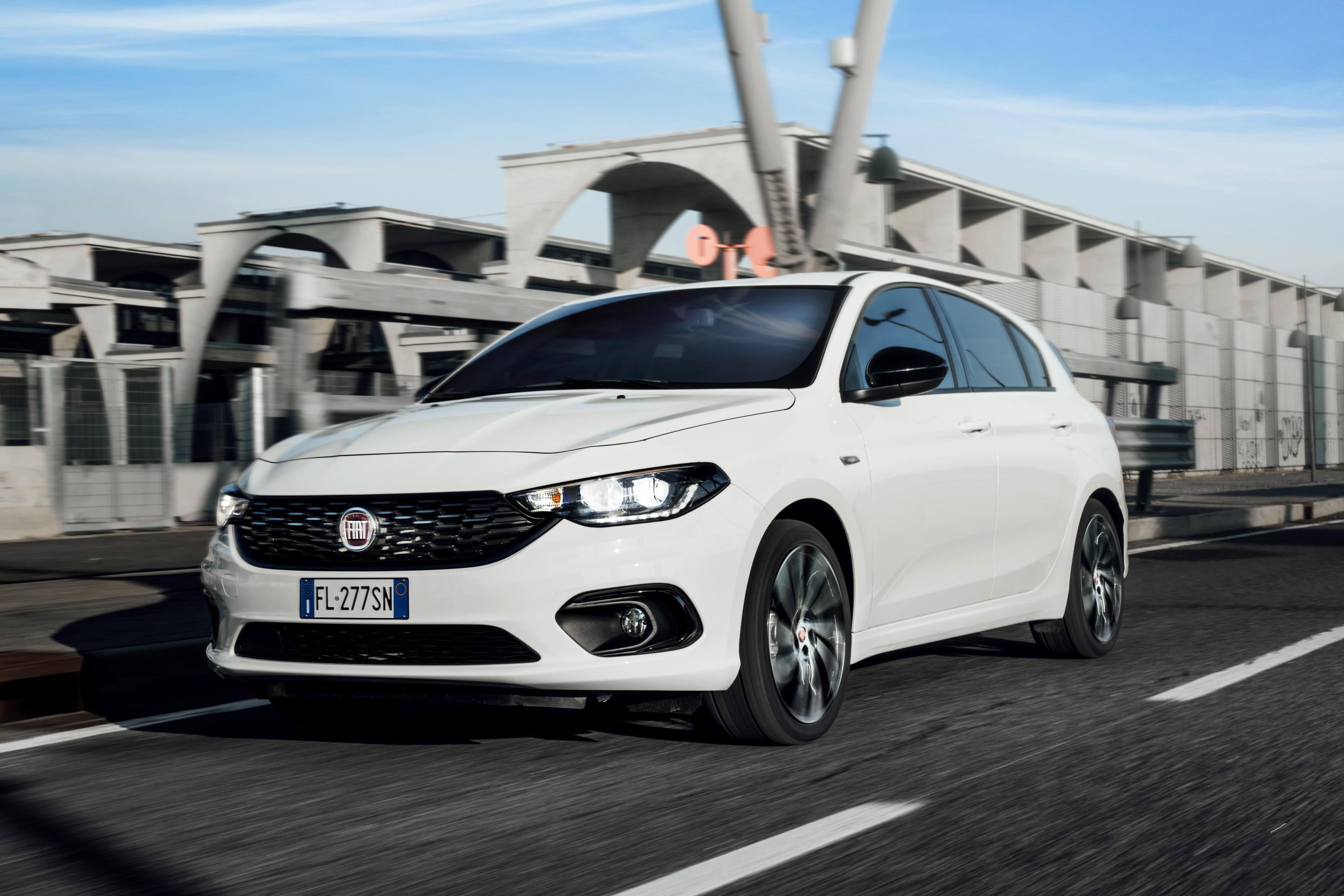 White Fiat Tipo driving on a wet road