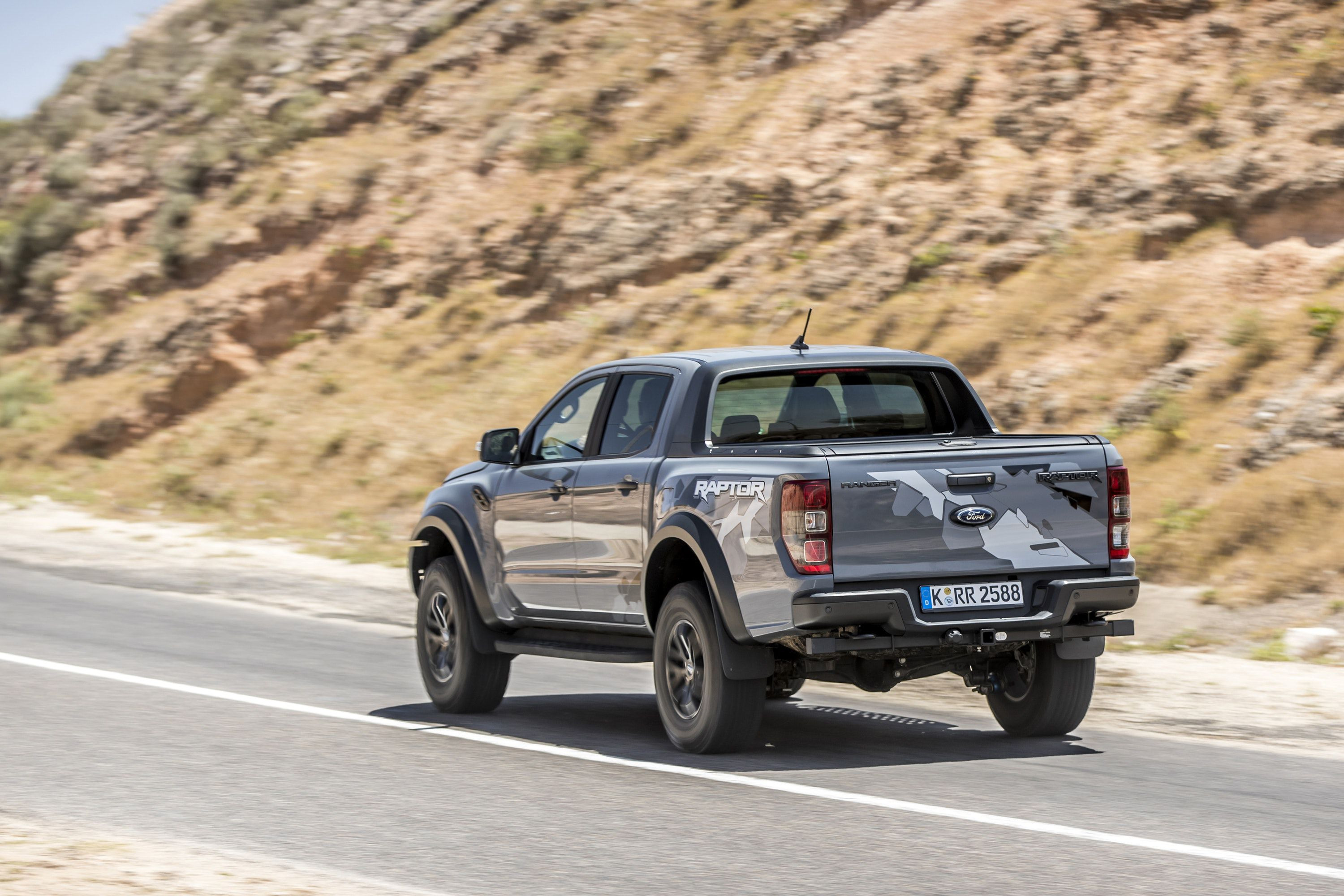 Rear of the Ford Ranger Raptor driving off down a road