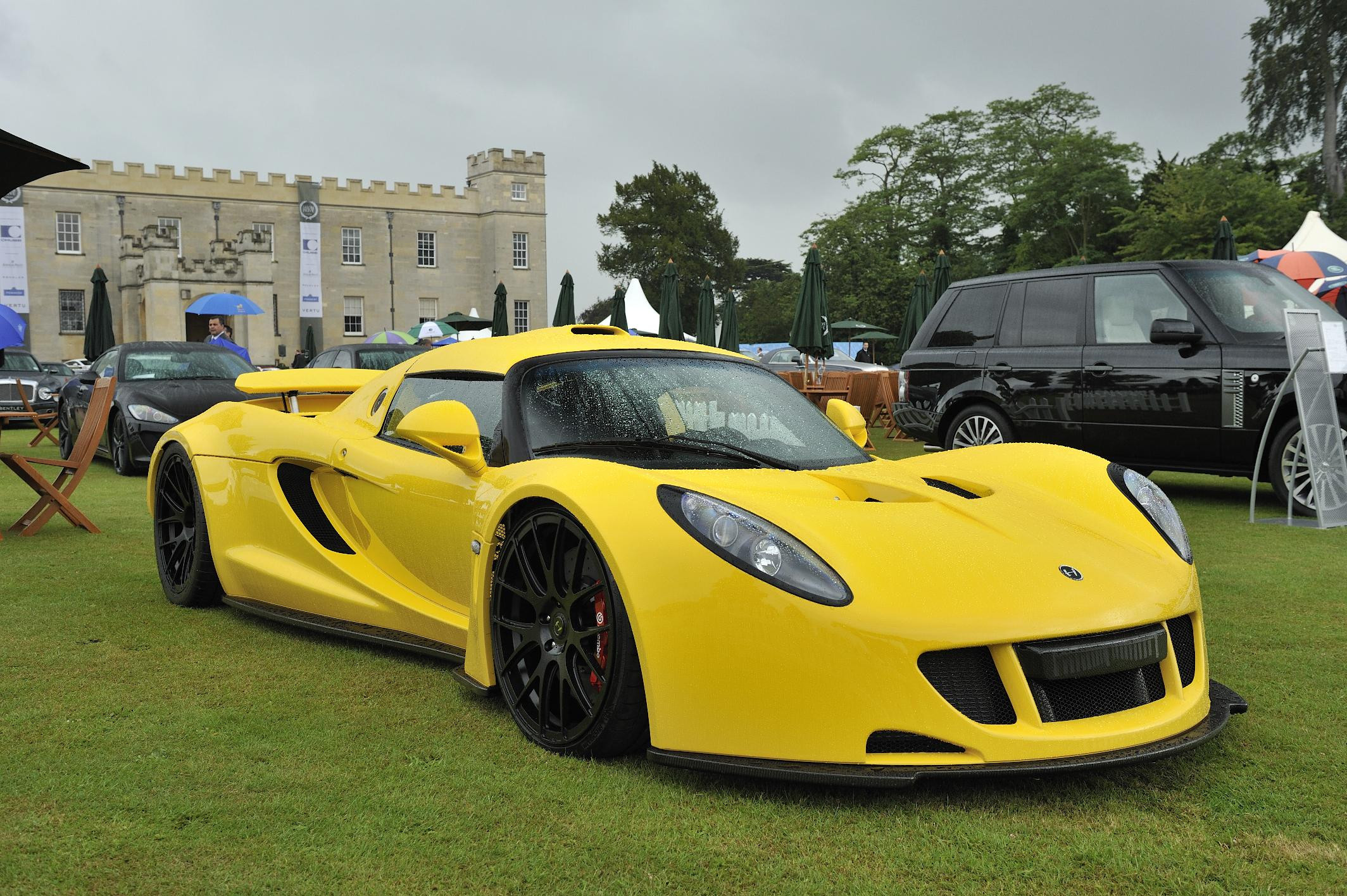Bright yellow Henessey Venom GT on display at a show