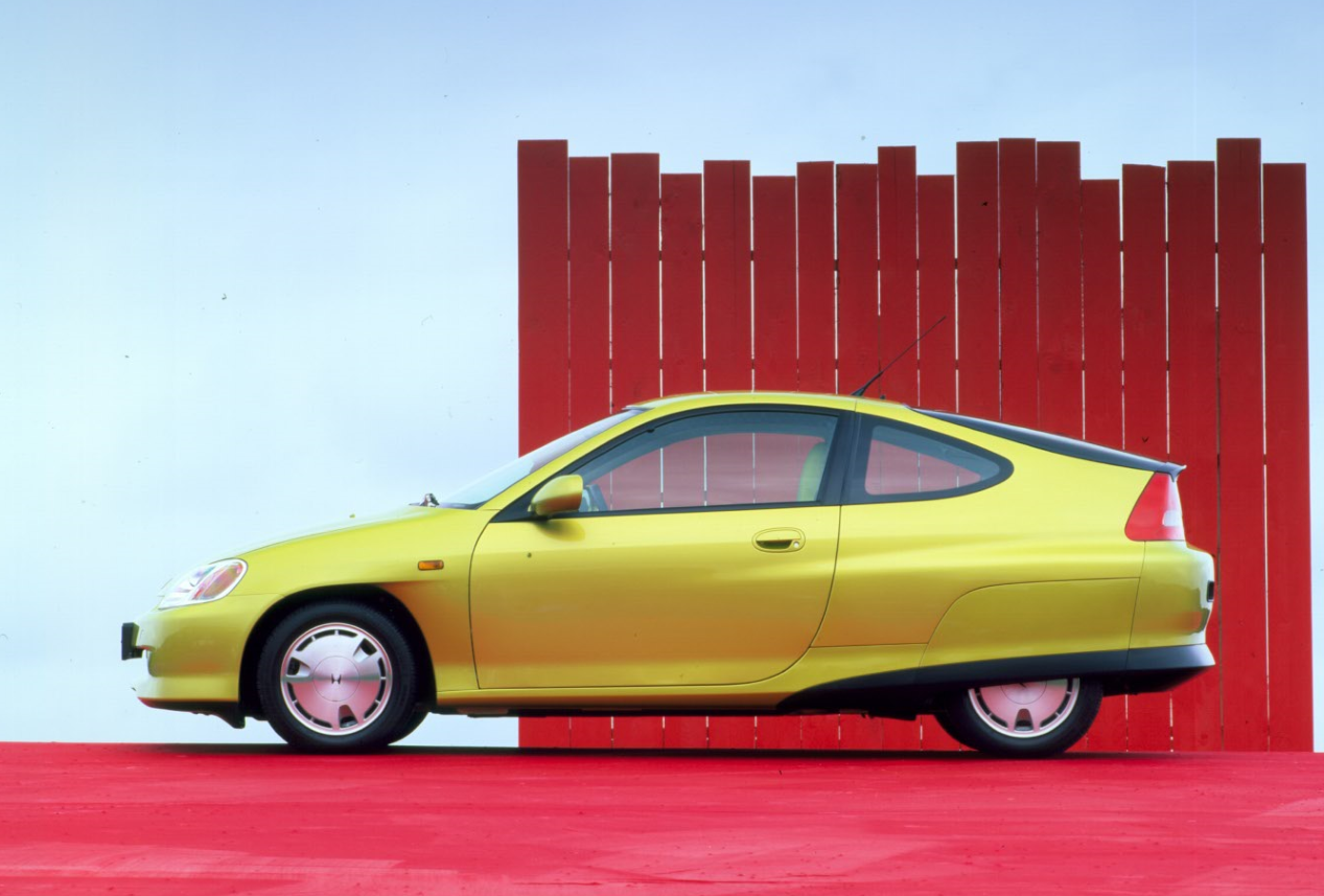 Citrus metallic electric Honda Insight on a red background