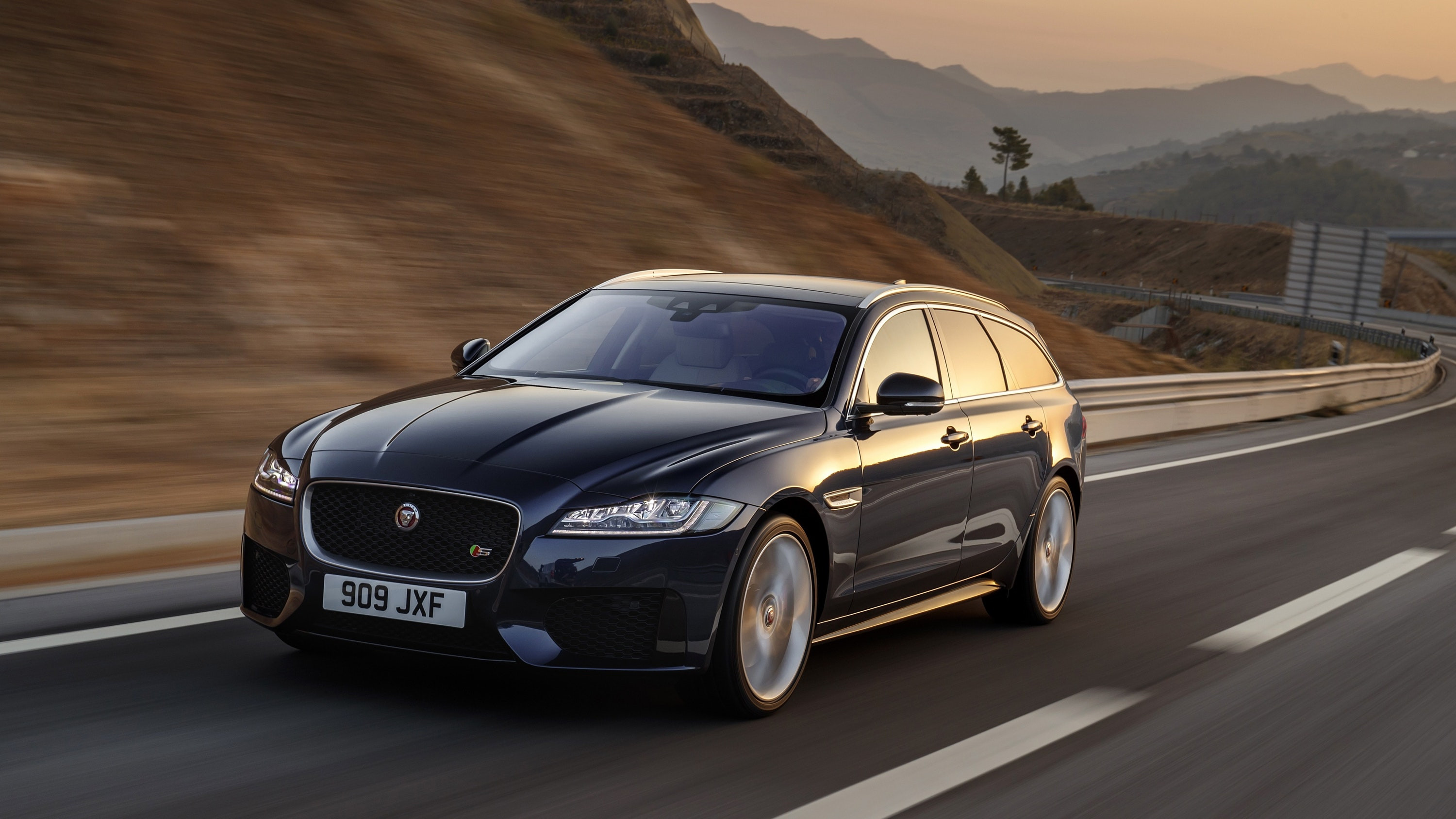 Jaguar XF Sportbrake moving at speed at dusk