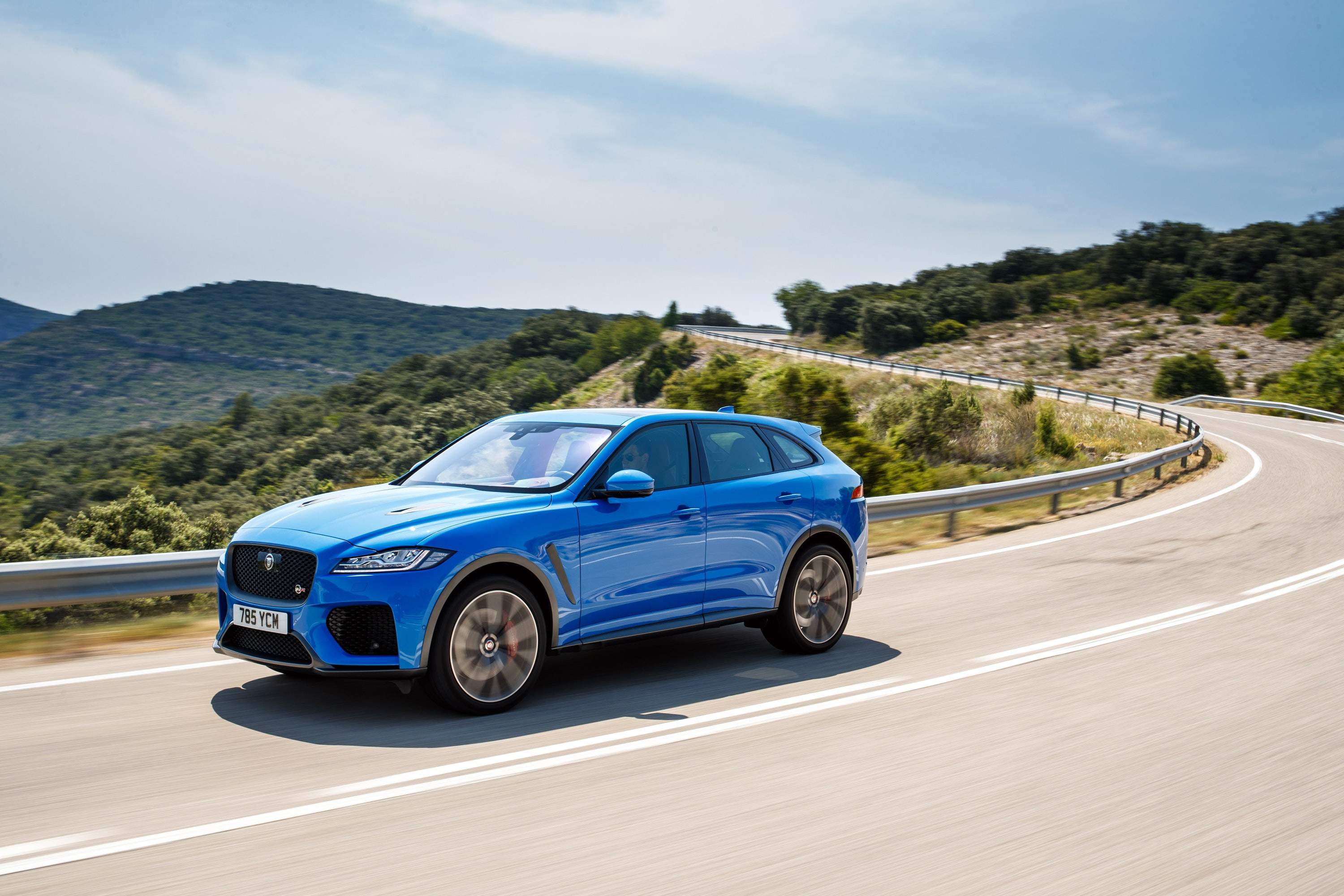 Jaguar F-Pace SVR, in Blue, driving down the road