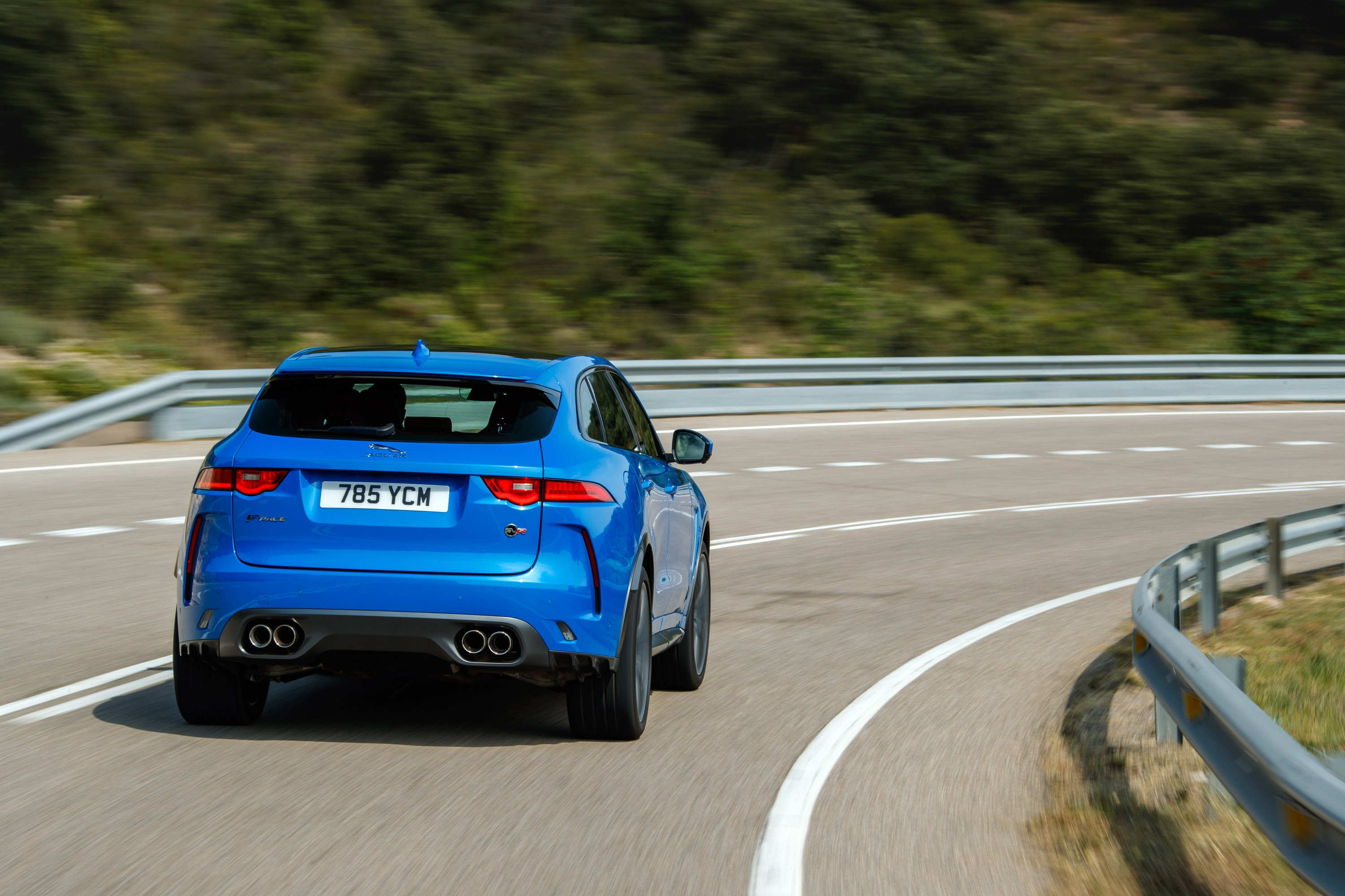 Rear of the Jaguar F-Pace SVR driving down the road