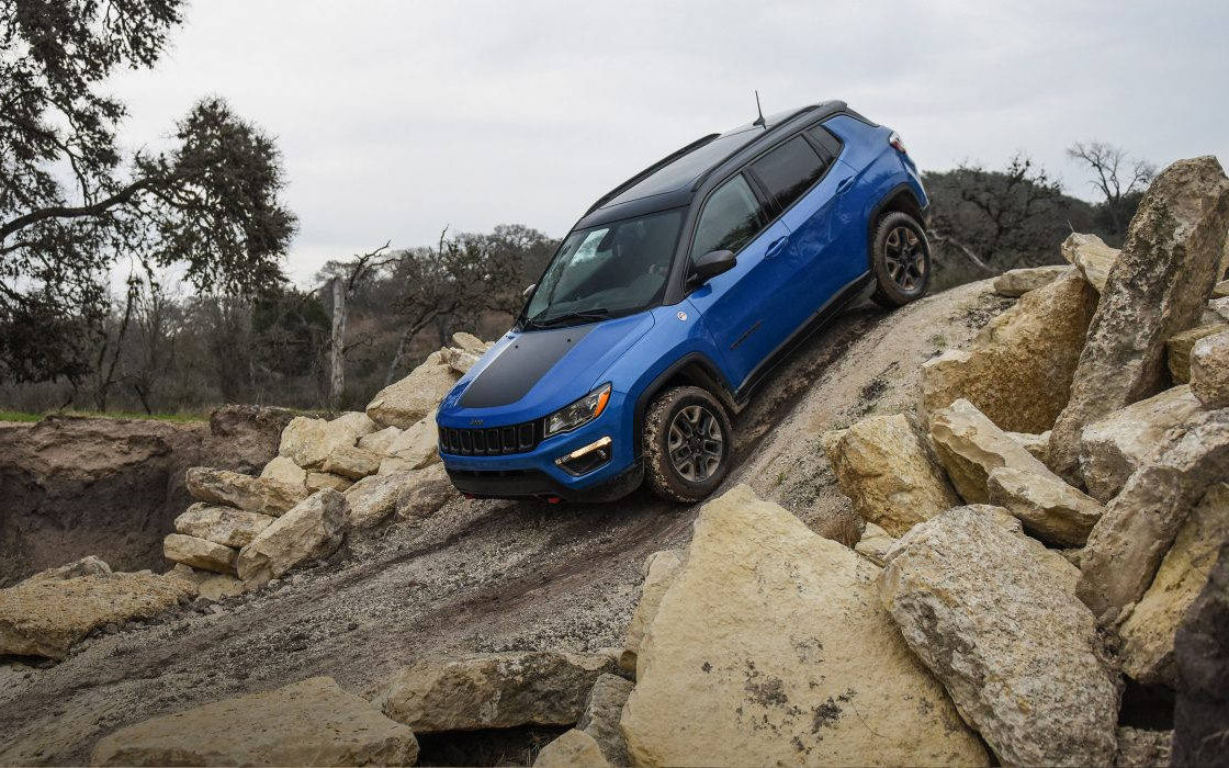 Blue Jeep Compass coming down a very steep incline