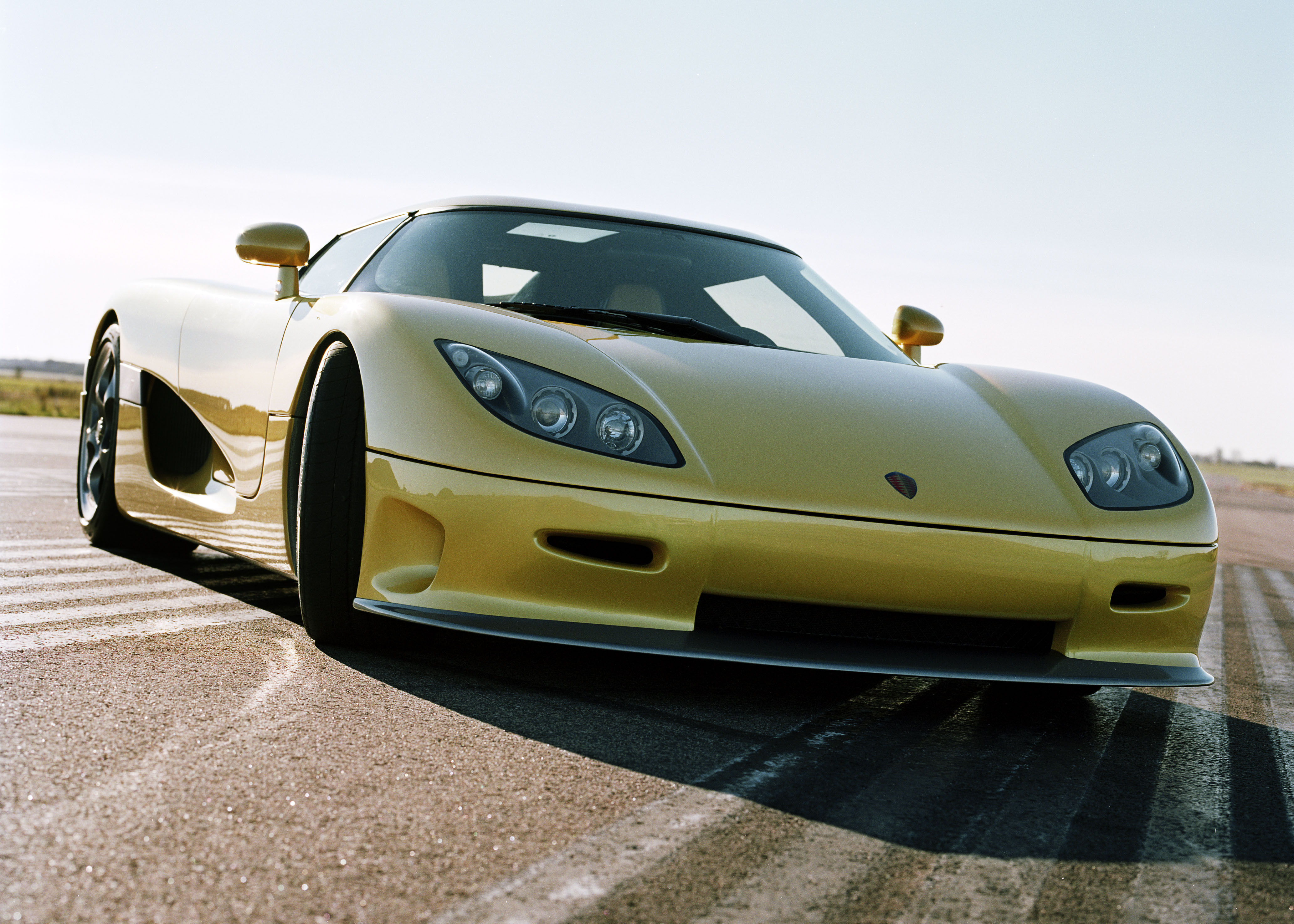 Pale yellow Koenigsegg CCR-3 on display at an aerodrome