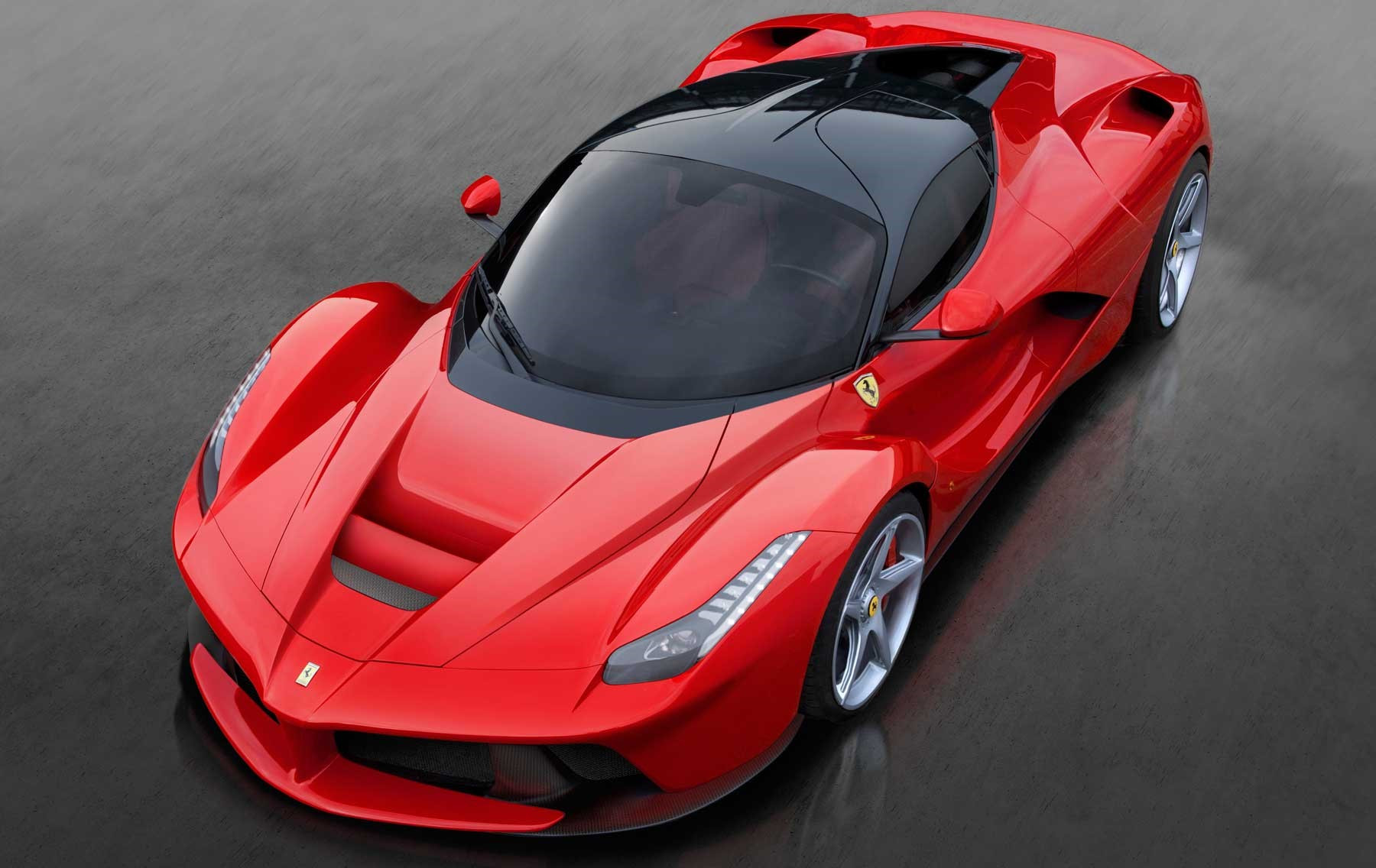 Bright red Ferrari LaFerrari shot from above
