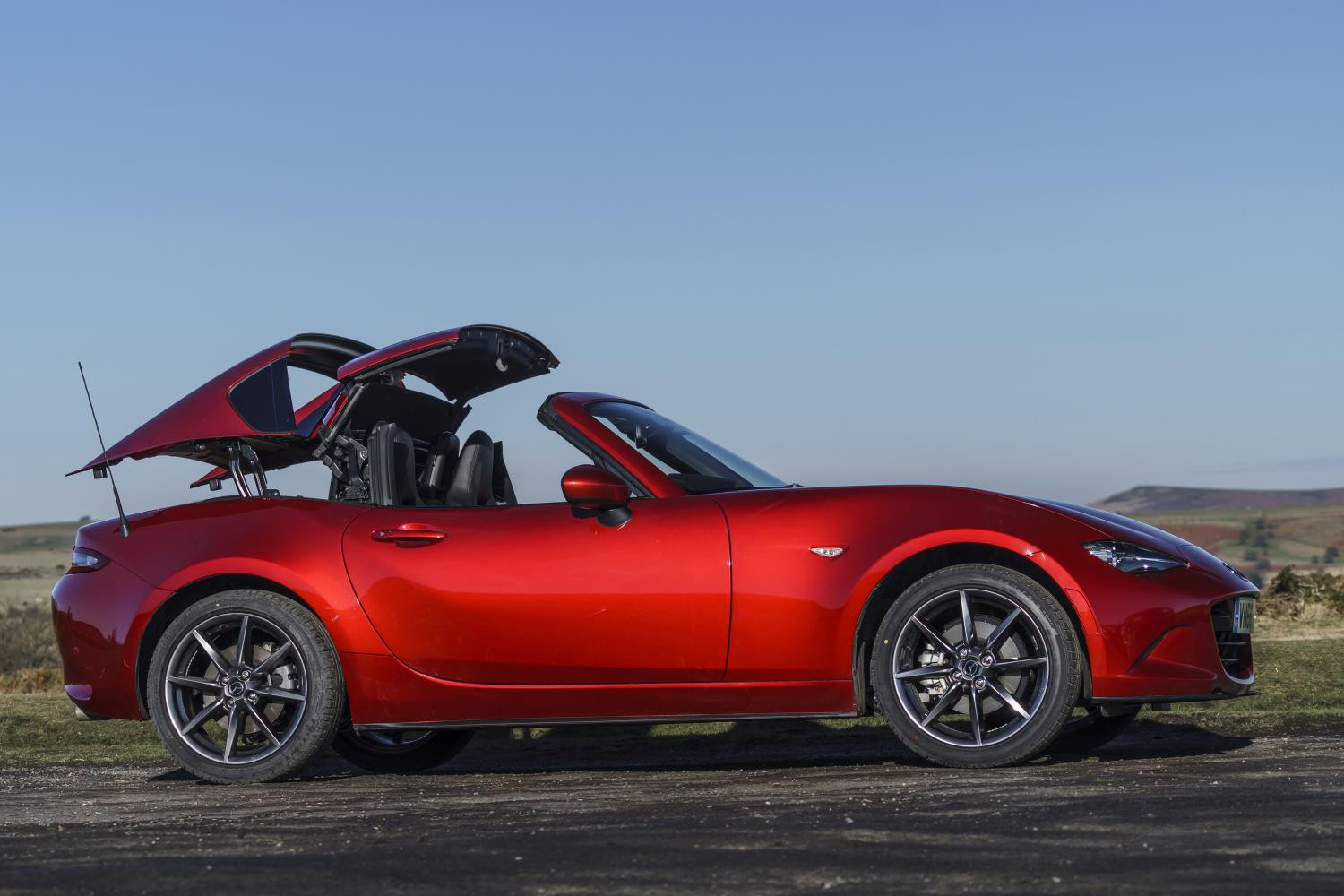 Mazda MX 5 RF with the roof half way down