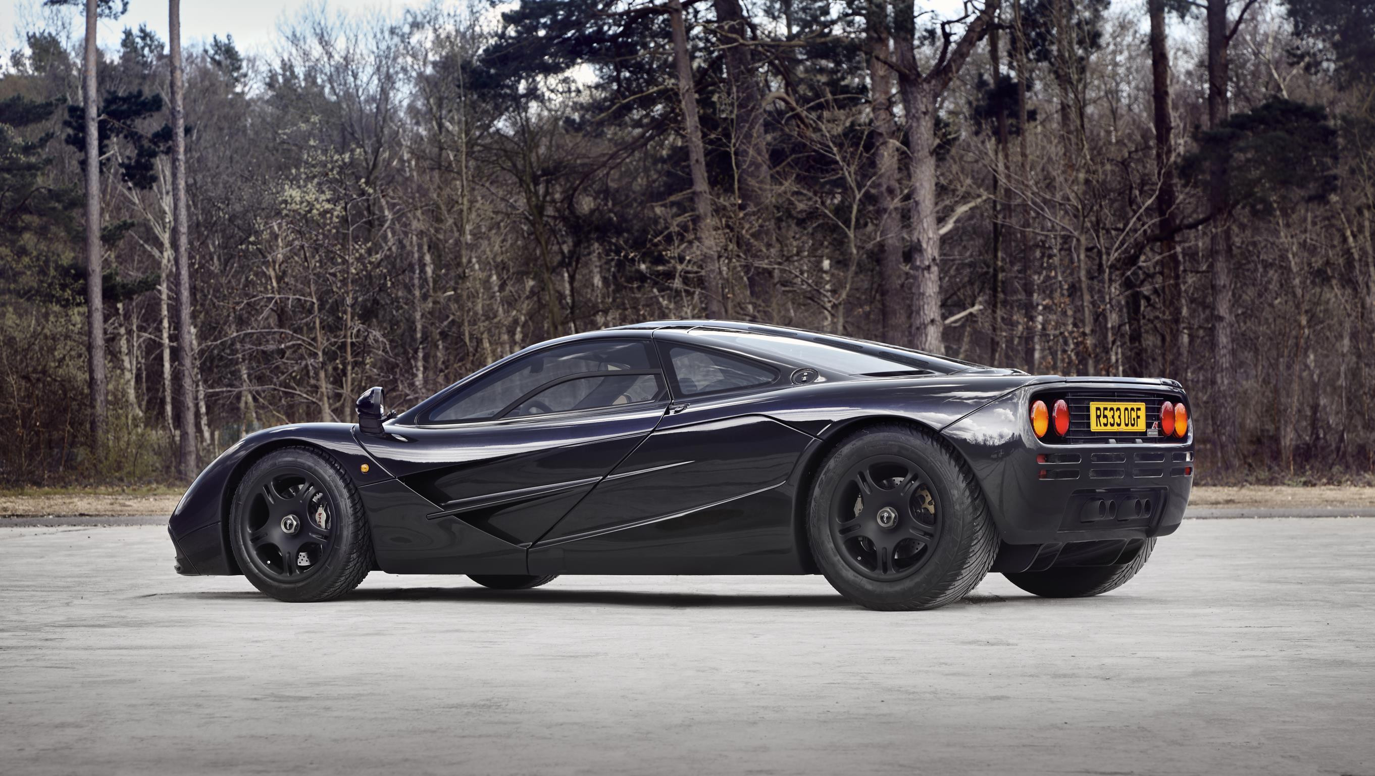 Black McLaren F1-57 parked up in some woods