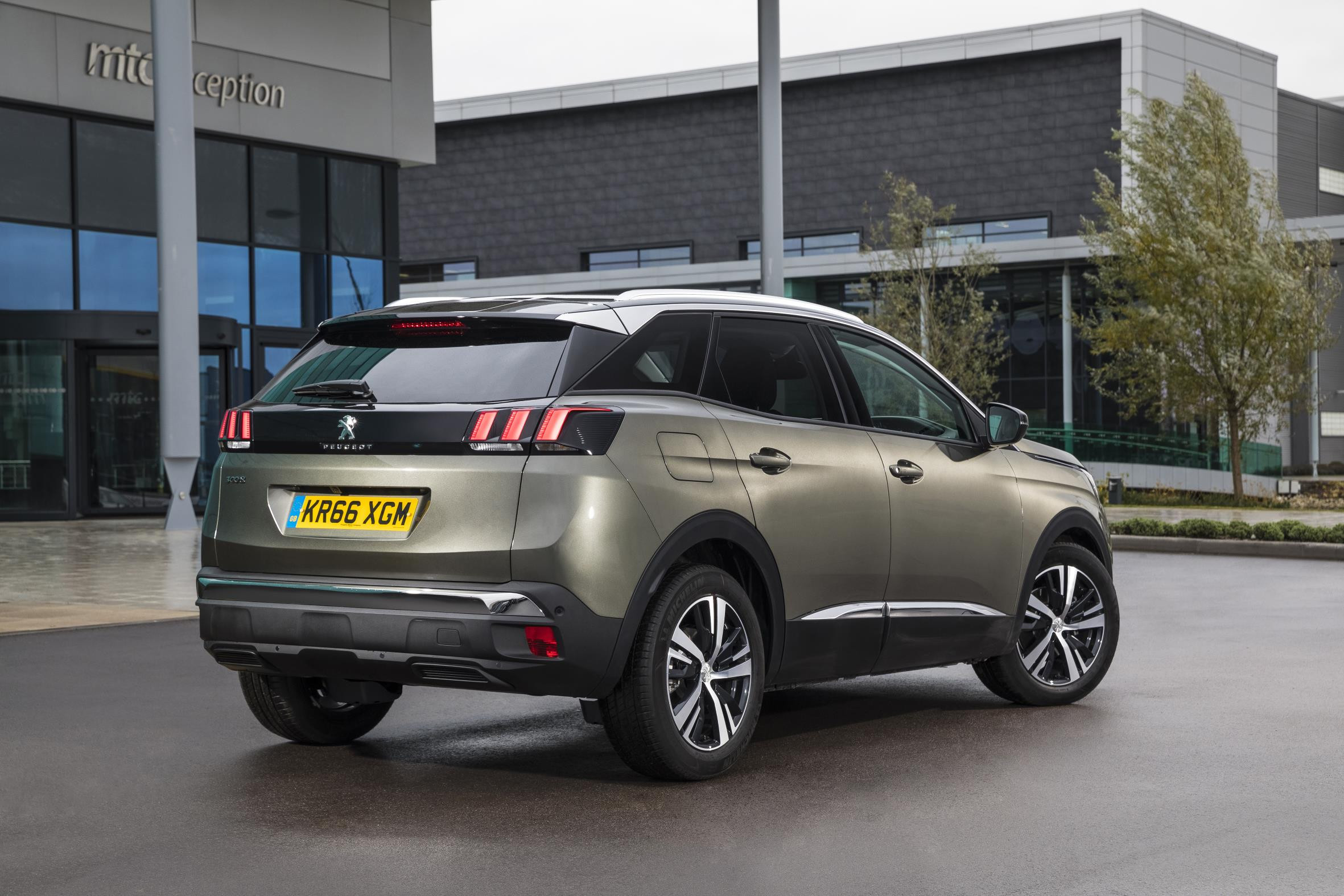 Grey Peugeot 3008 seen from two thirds rear view parked