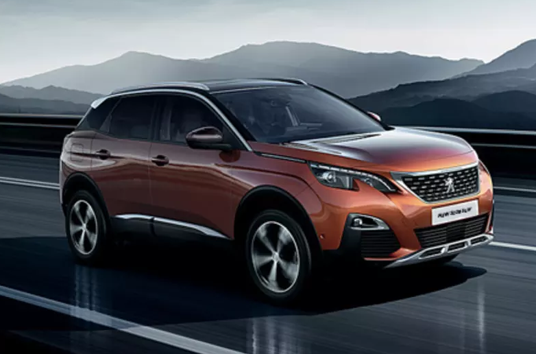 Orange Peugeot 3008 SUV on a very shiny black road