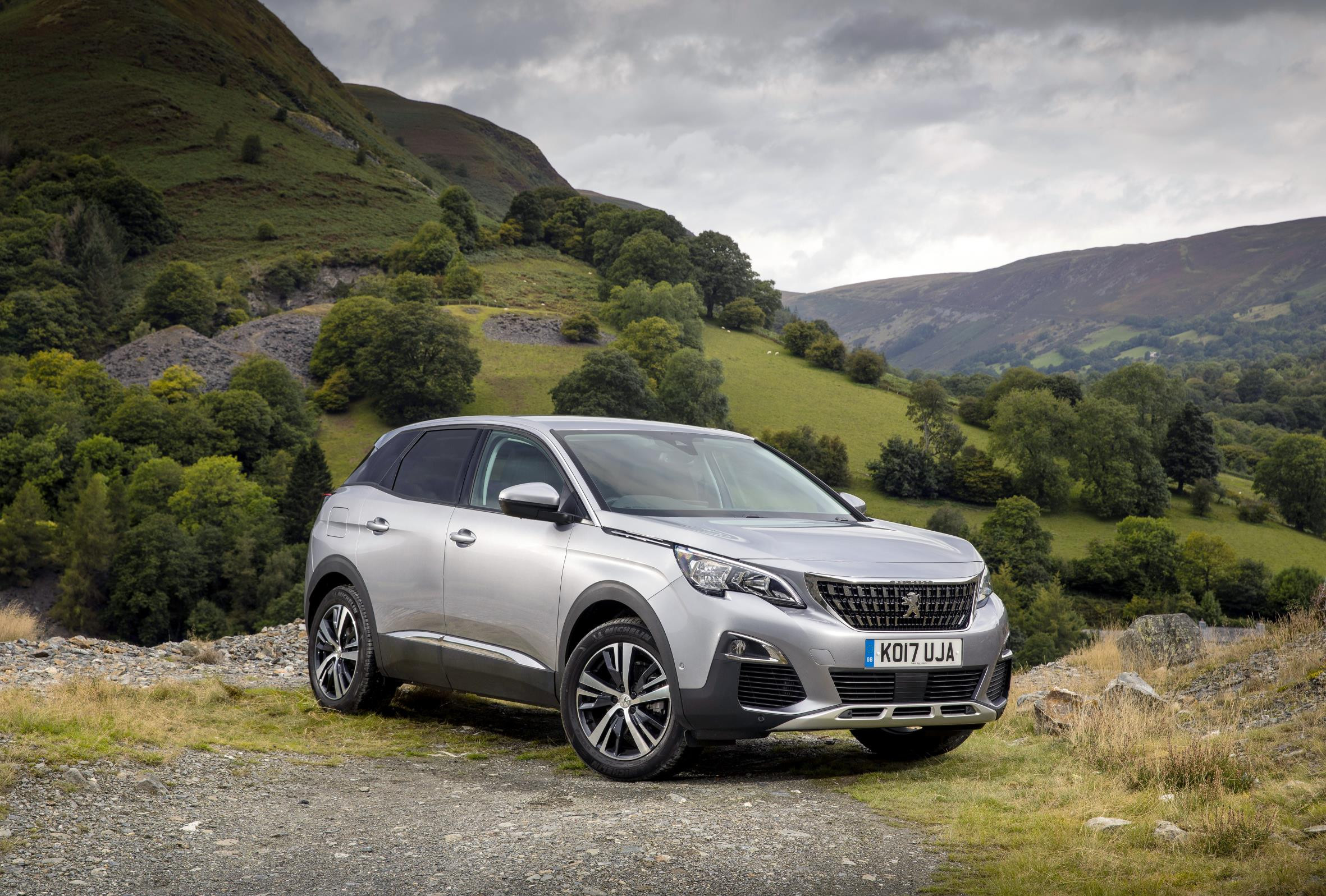 SIlver Peugeot 3008 SUV parked with a dramatic backdrop