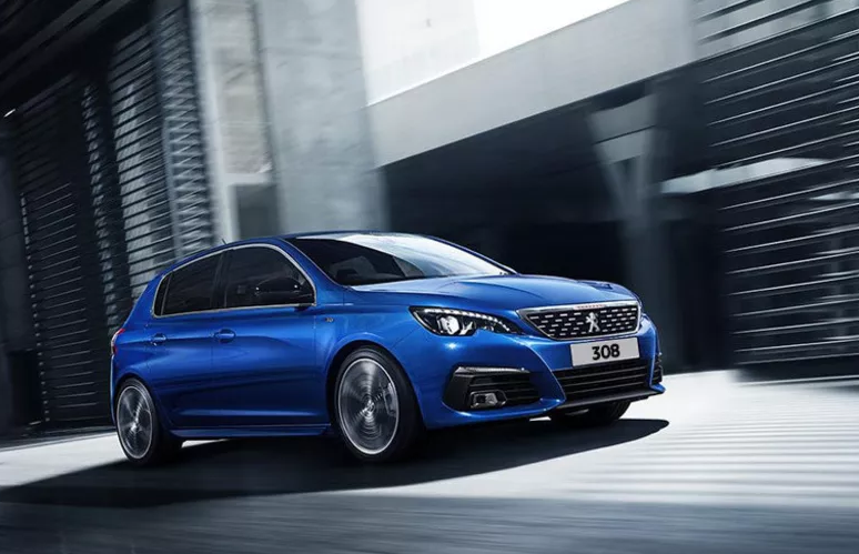 Bright blue Peugeot 308 against an industrial backdrop