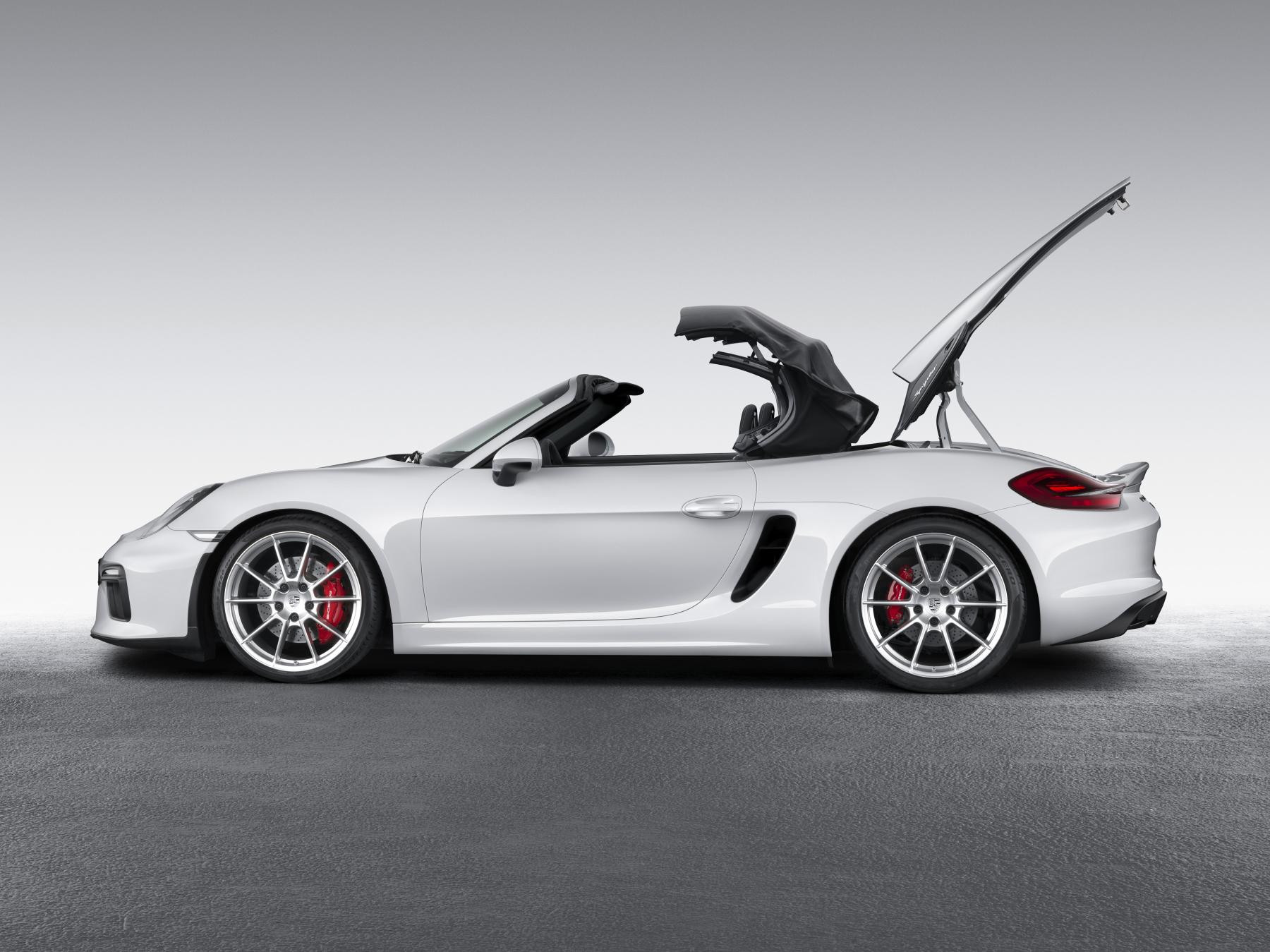 White Porsche Boxster 788 parked sideon with roof going down