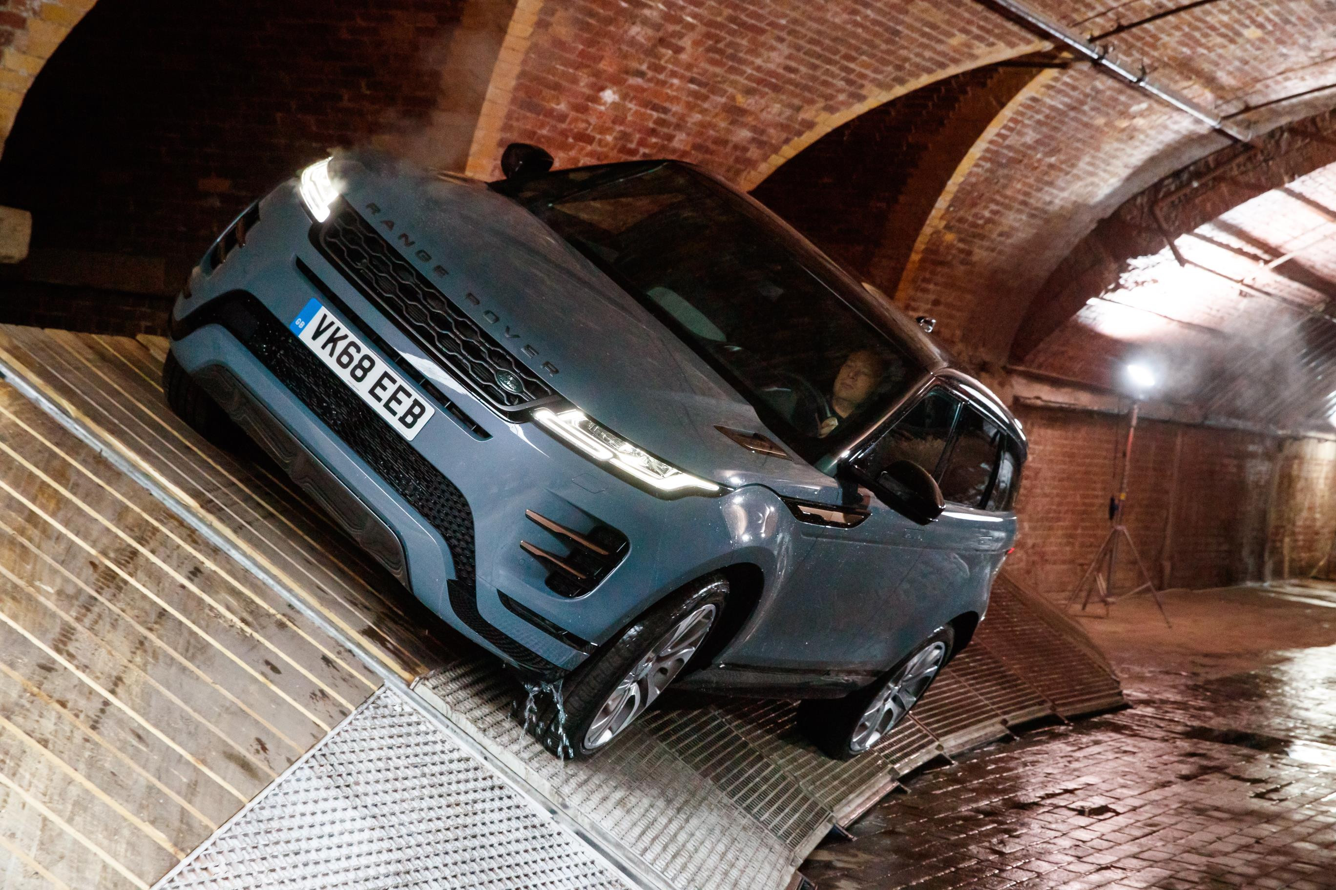 White Range Rover Evoque driving through a tunnel filled with water