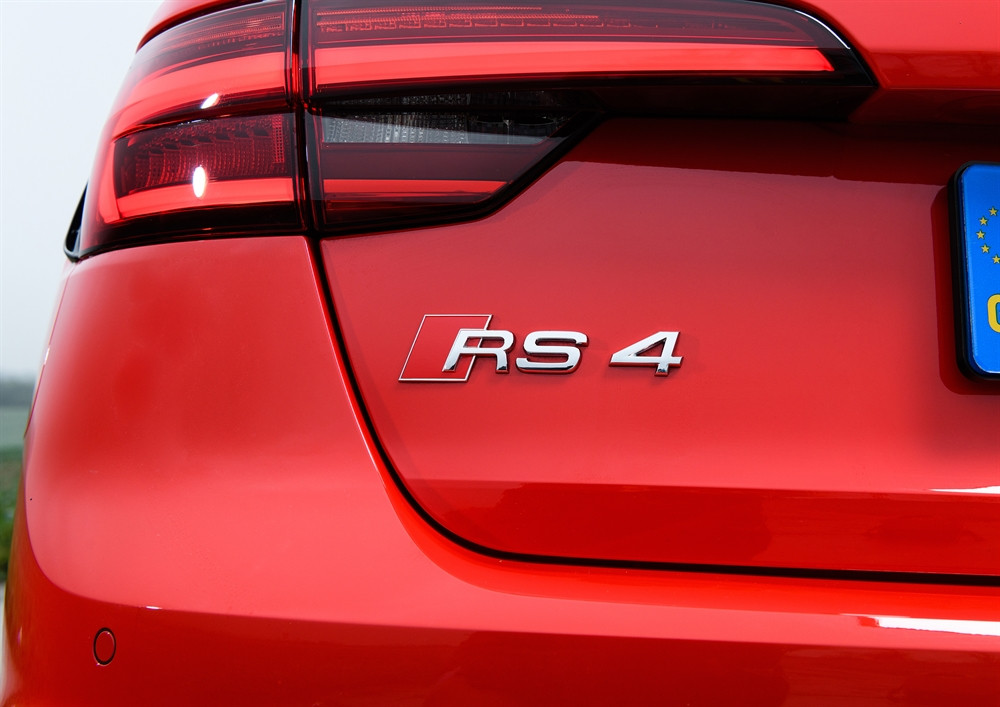 Rear Audi RS 4 badge on a red car