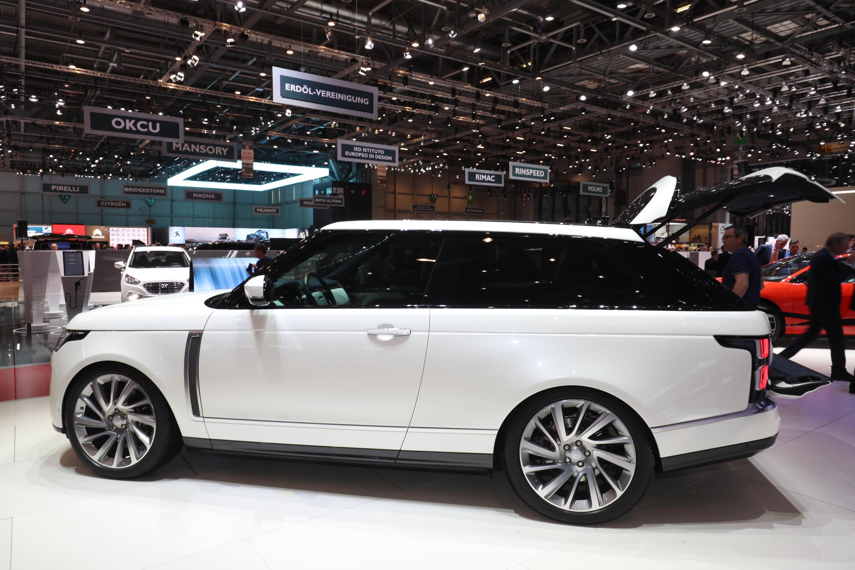 White Range Rover SV coupe at a motor show seen side on