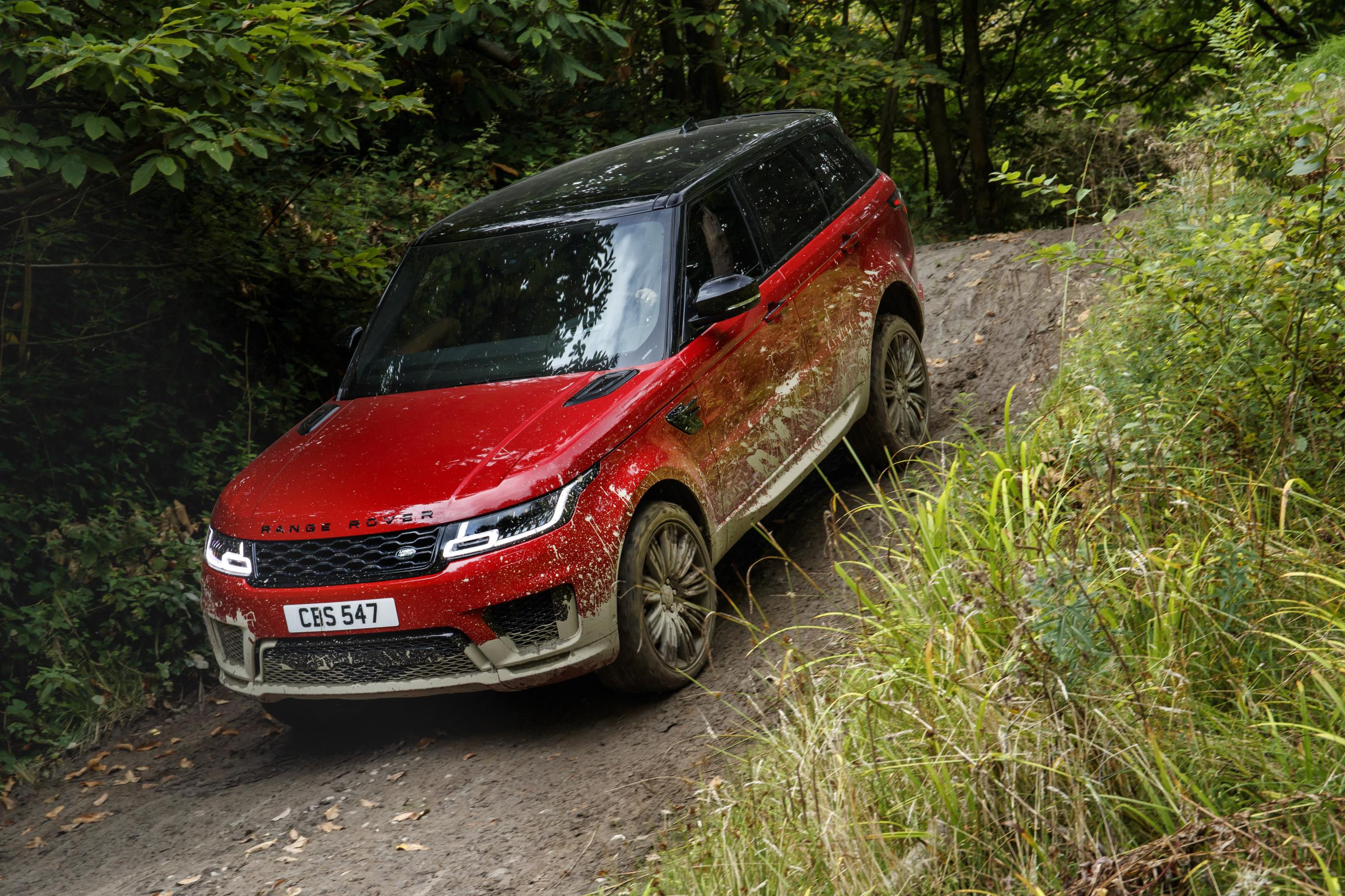 Red Range Rover sport coming down a steep hill