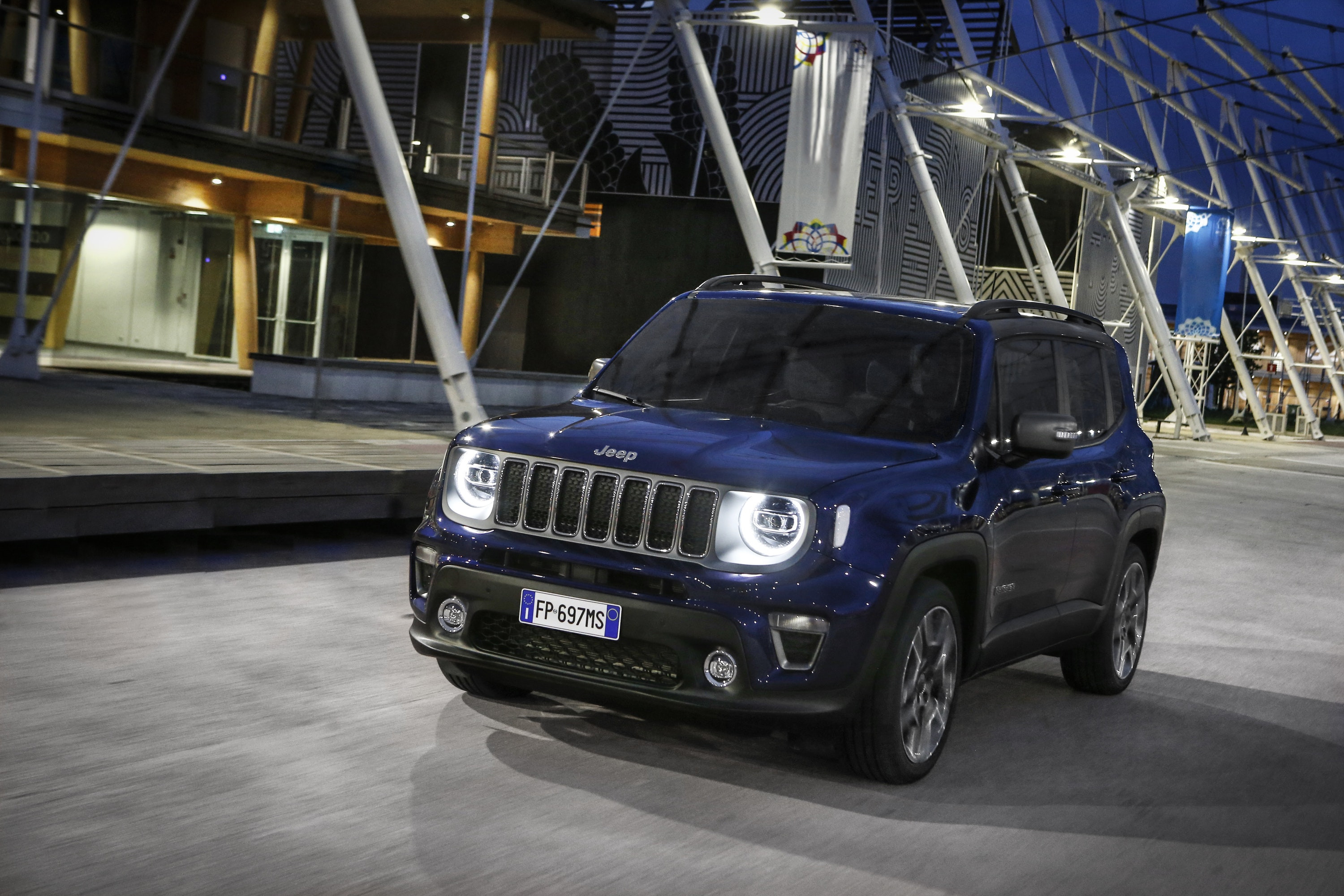 Blue Jeep Renegade driving at night