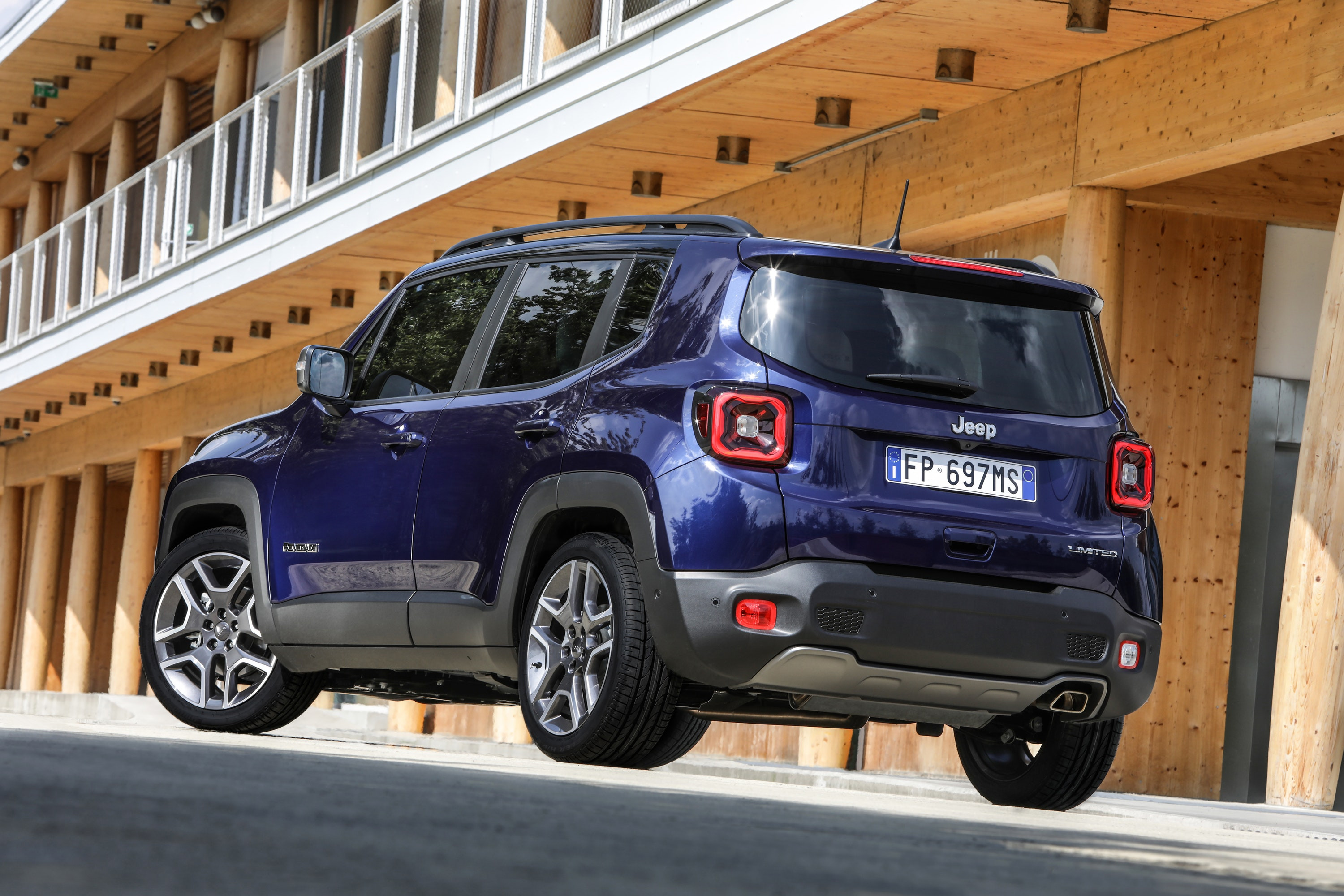 Blue Jeep Renegade two thirds on driving away from you
