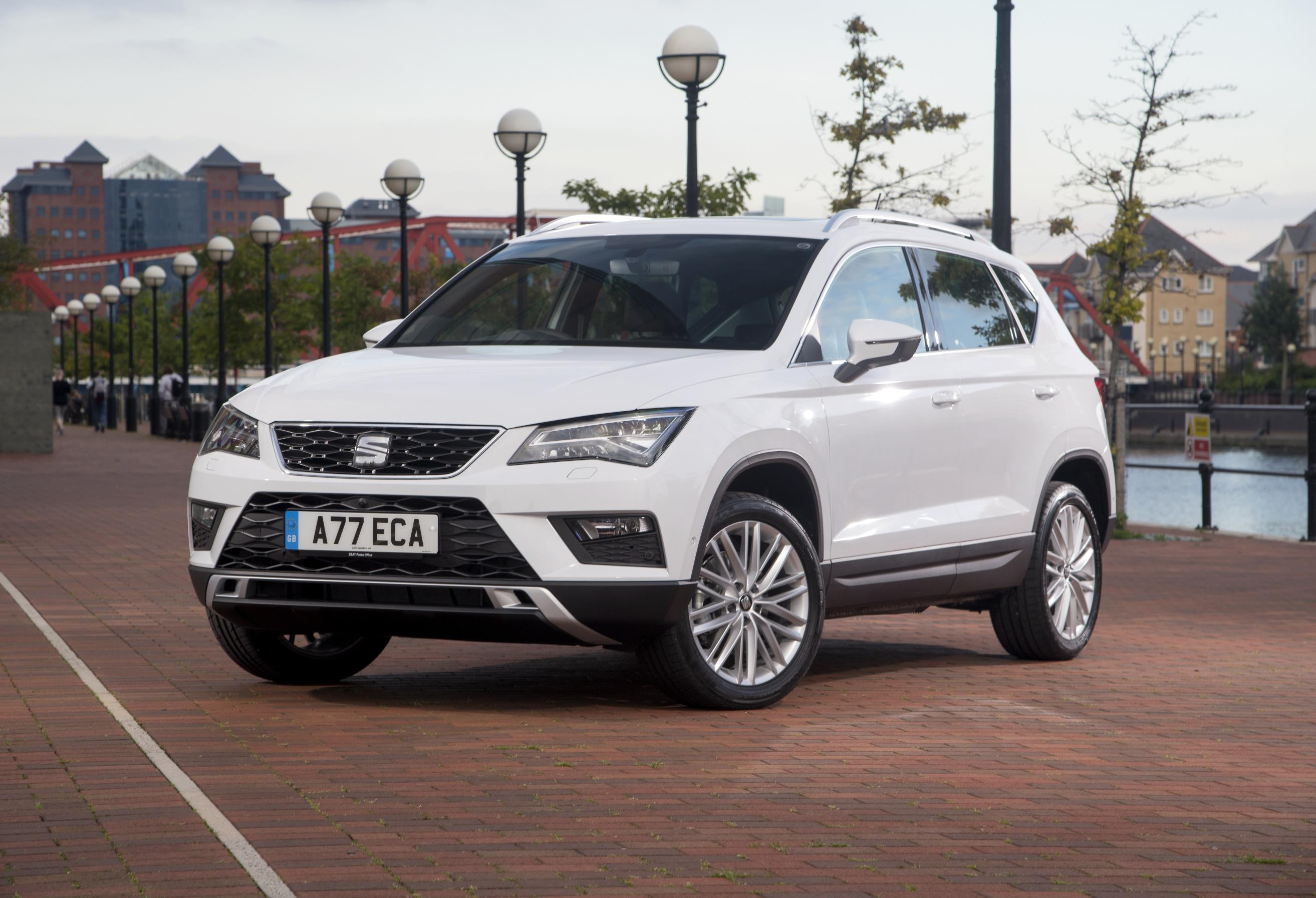 White SEAT ATeca parked two thirds side on outside large office block