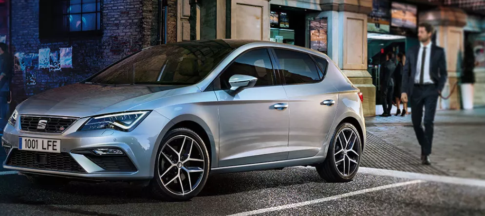 SEAT Leon in silver against an urban backdrop