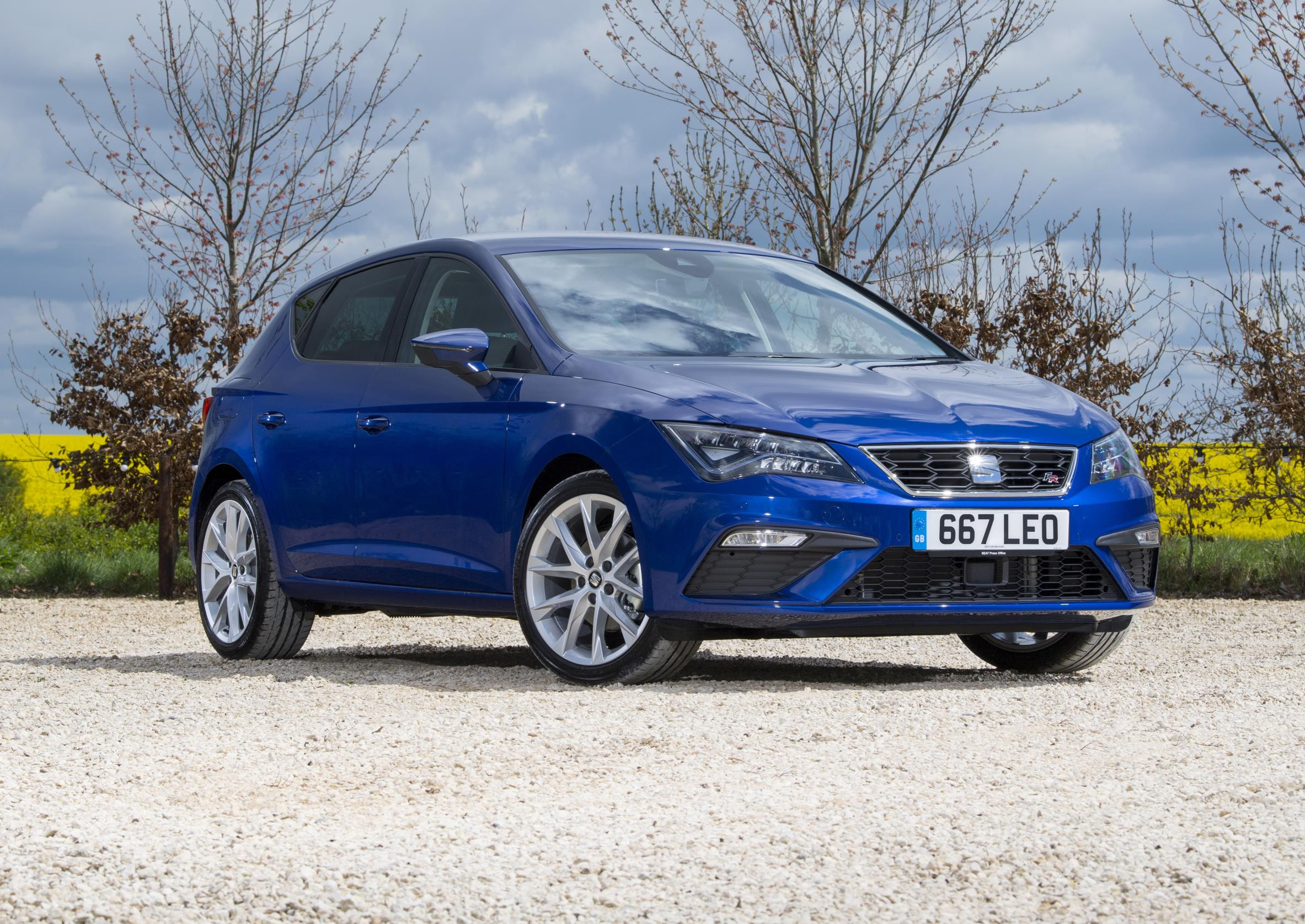 Blue SEAT Leon parked two thirds side on