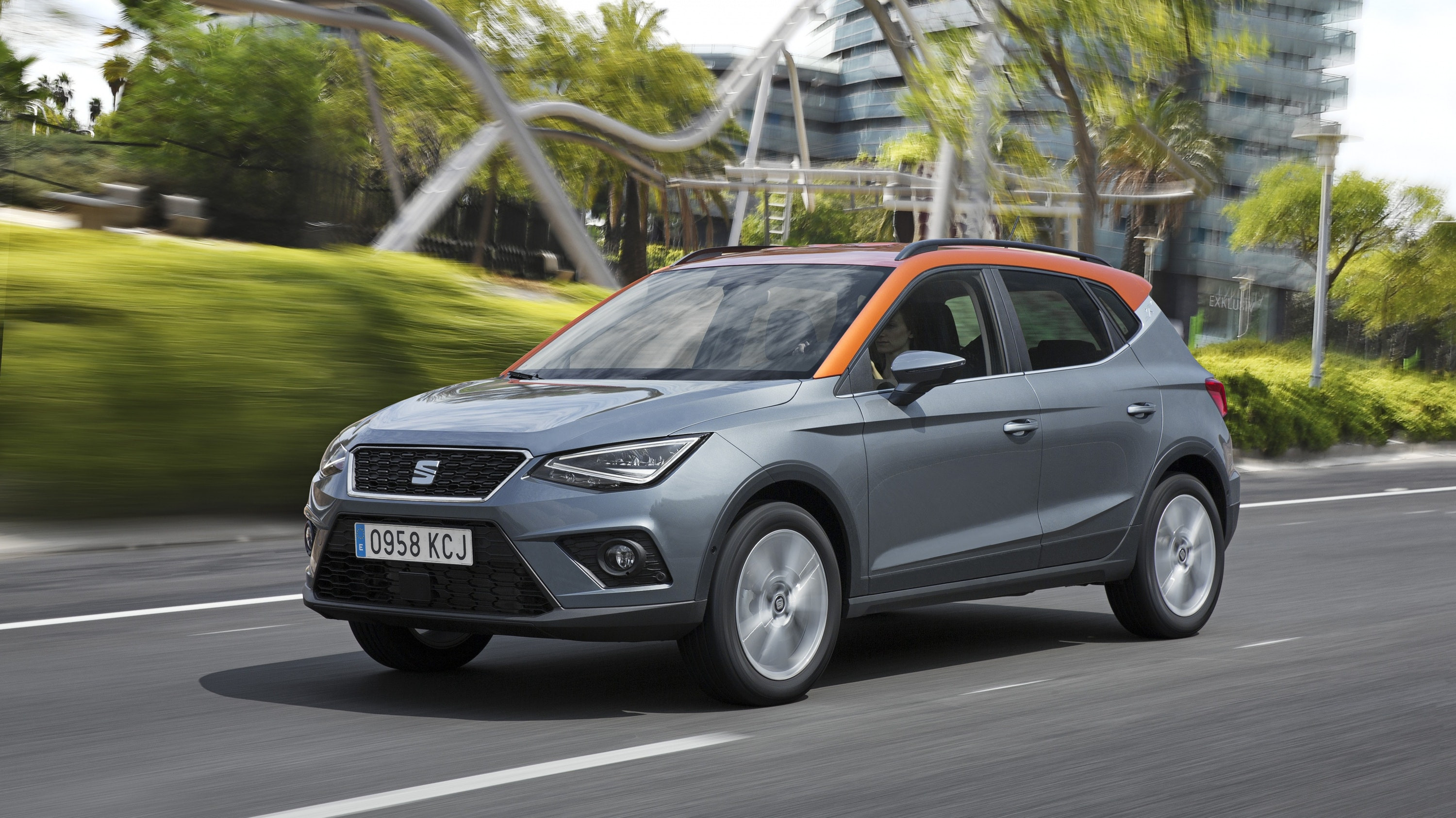 Grey and orange SEAT Arona on the move