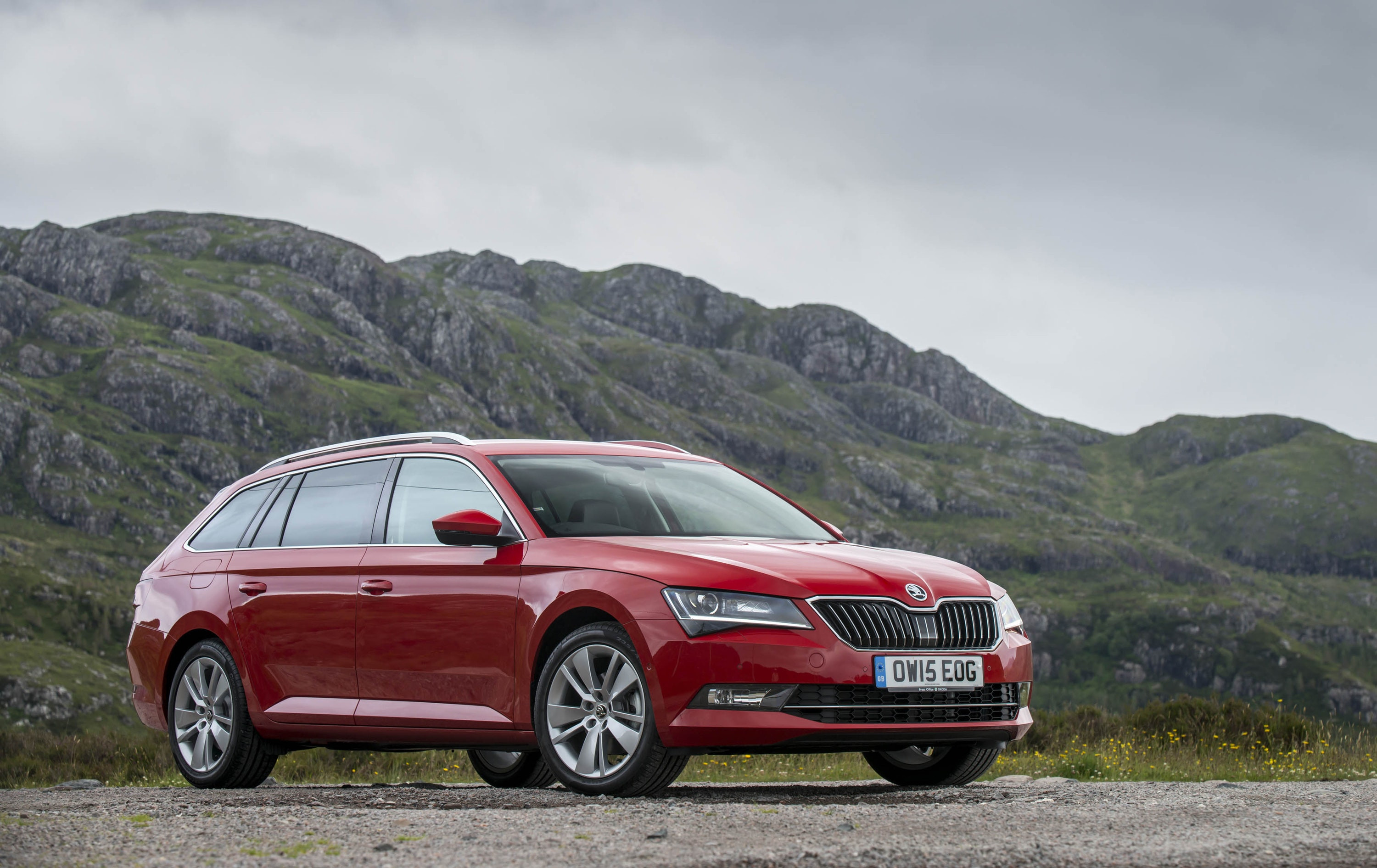 Red Skoda Superb estate parked in beautiful countryside