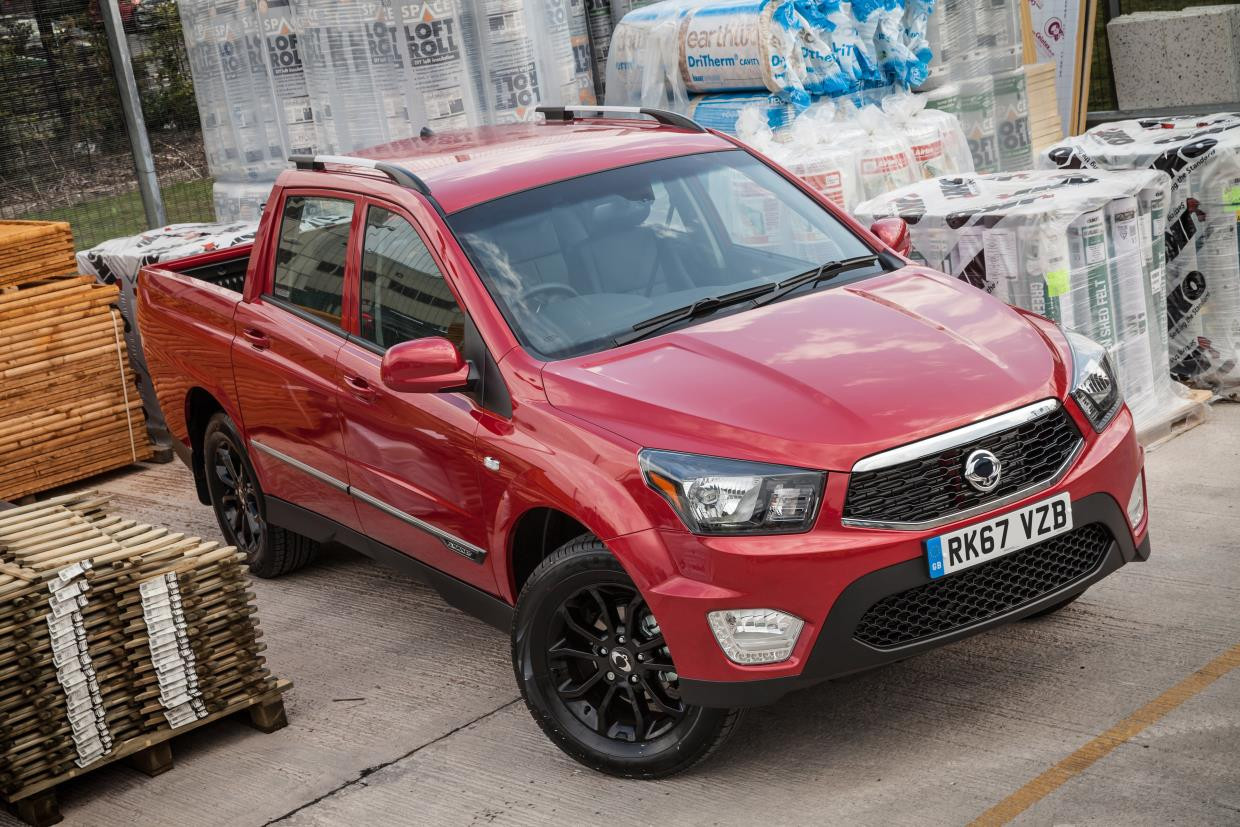 Red SsangYong parked in a builders yard