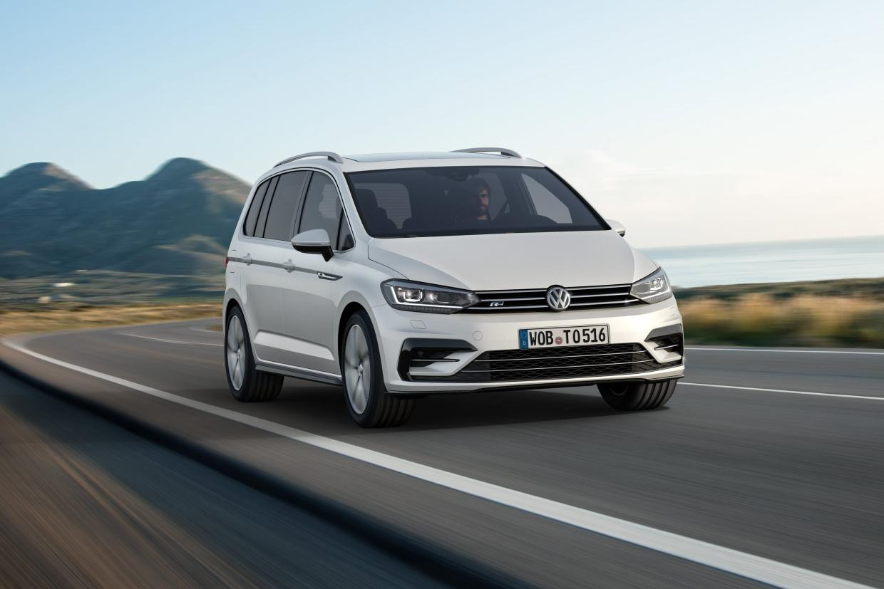 Siver Volkswagen Touran whizzing towards you