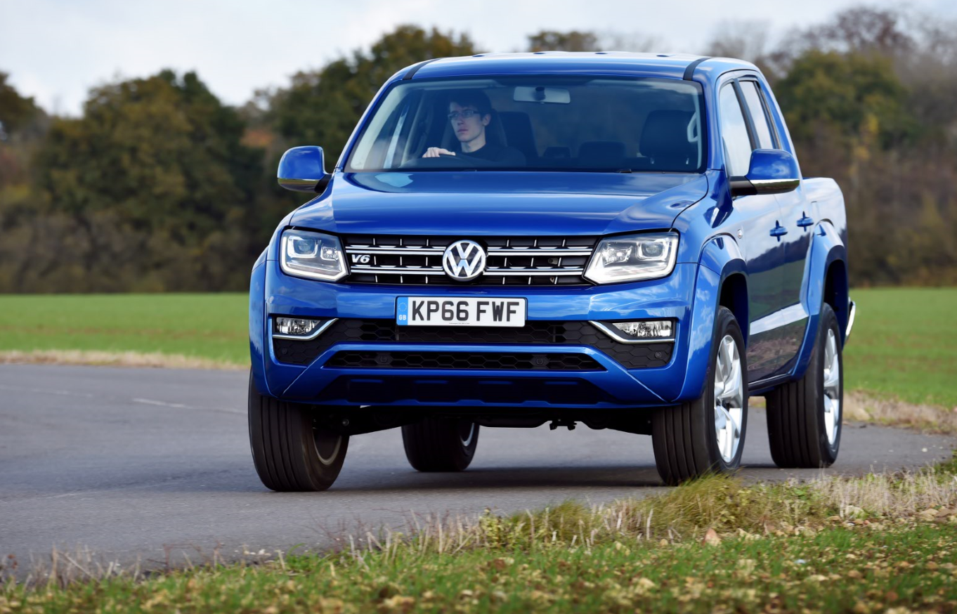 Blue Volkswagen Amarok being driven towards you