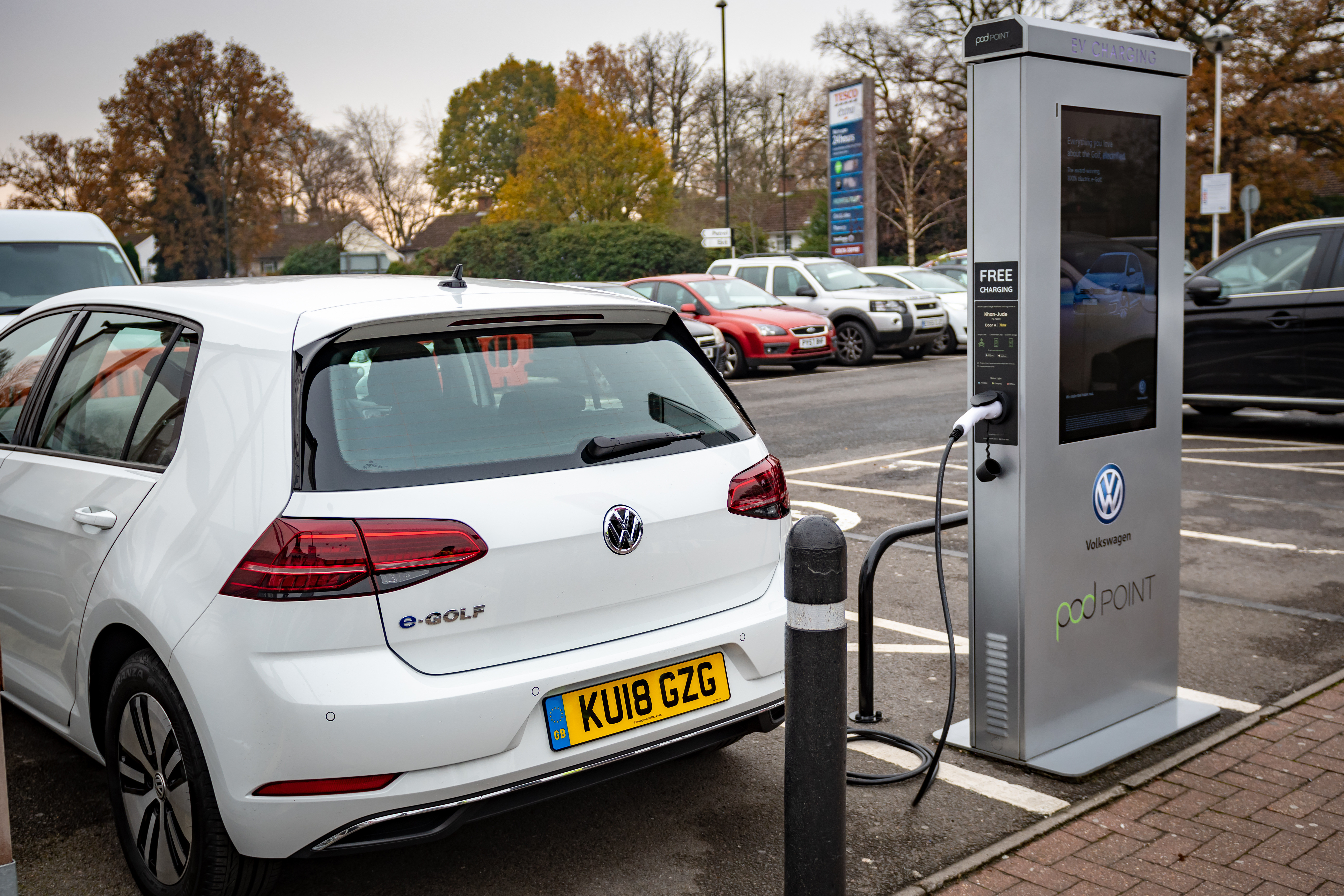 Volkswagen Golf charging up at Tesco Pod Point