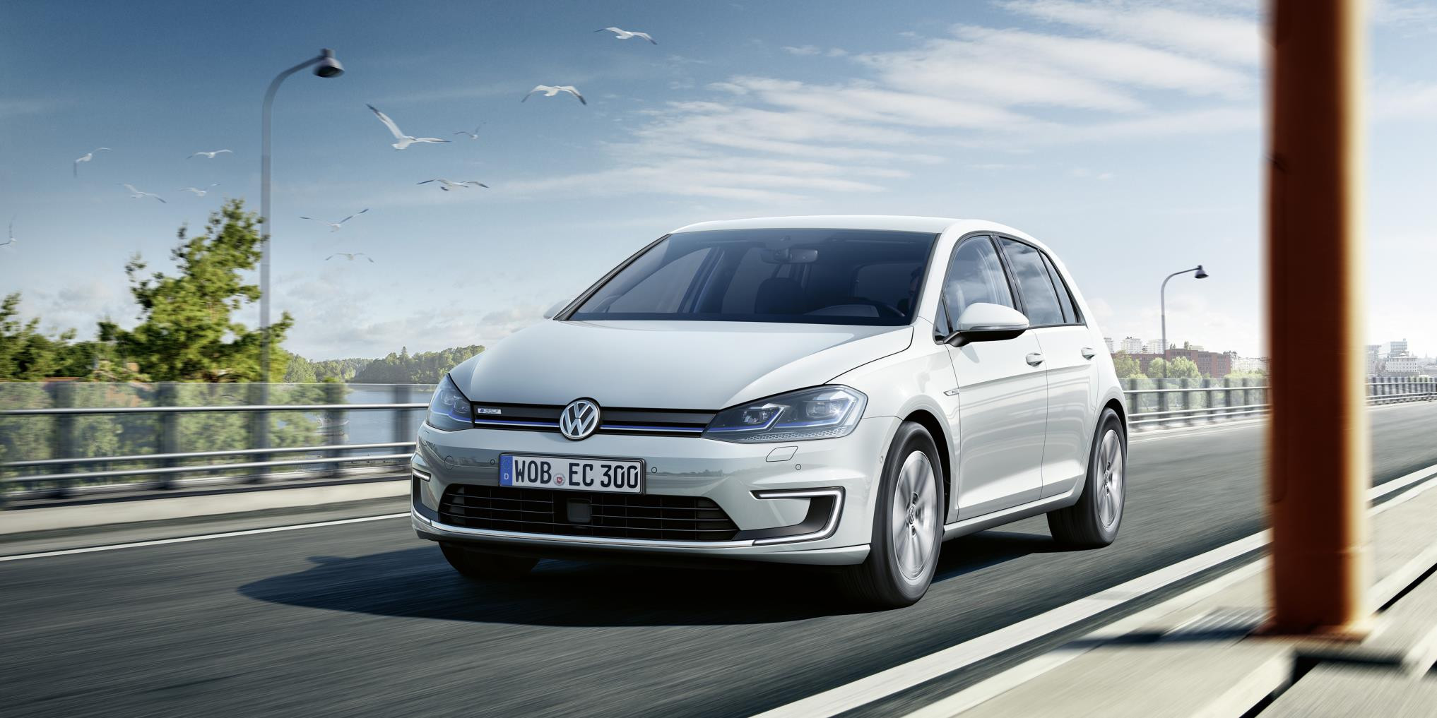 White Volkswagen e-Golf driving towards you
