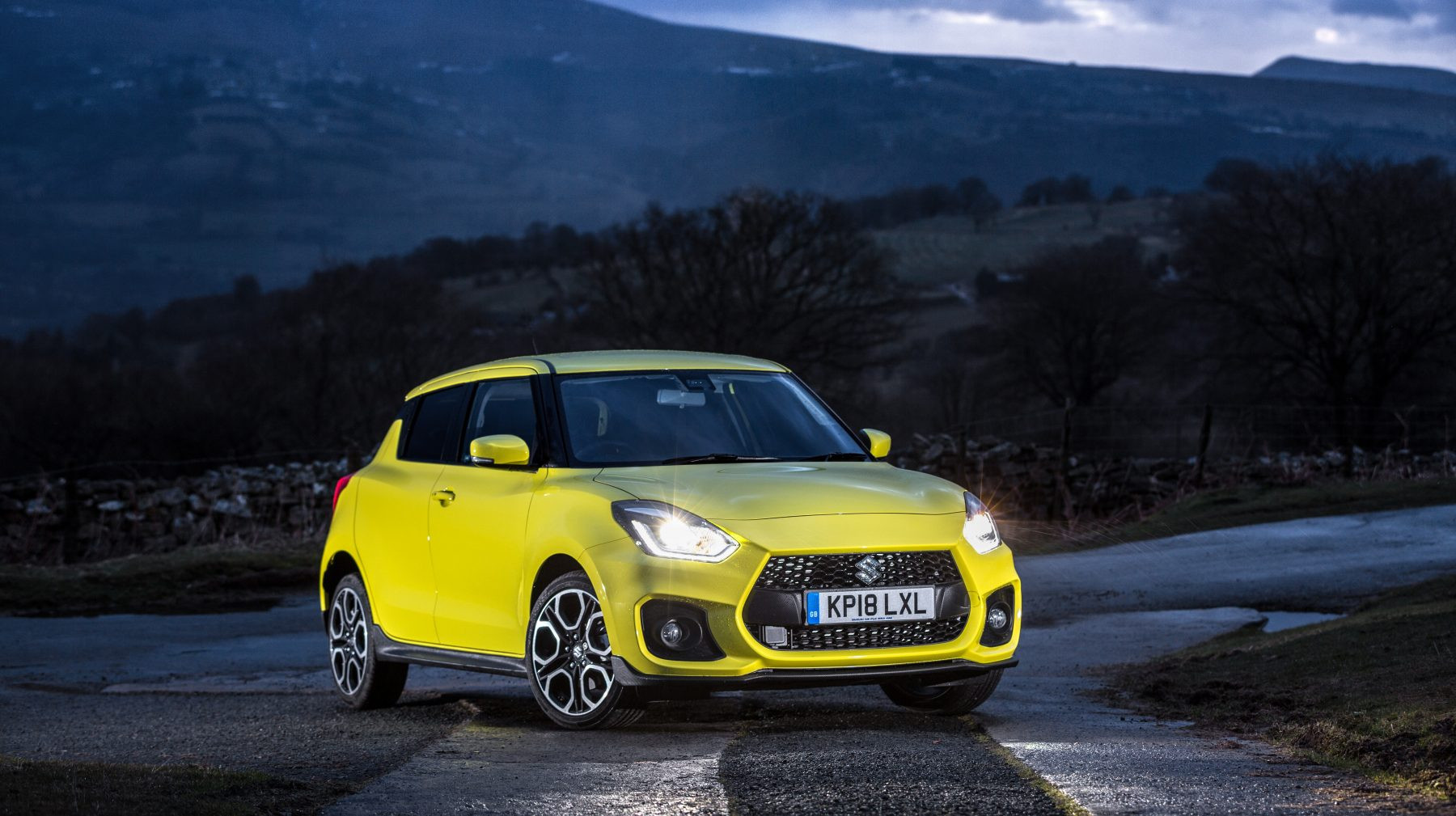Yellow Suzuki Swift Sport