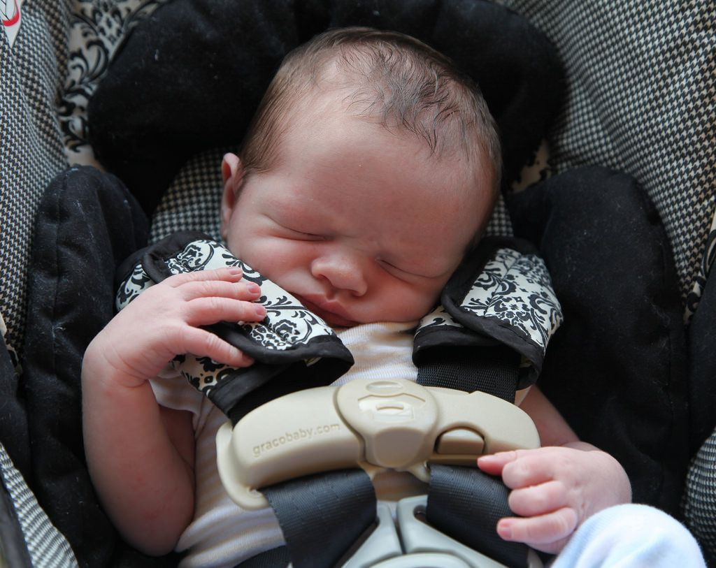 Sleeping baby in a car seat
