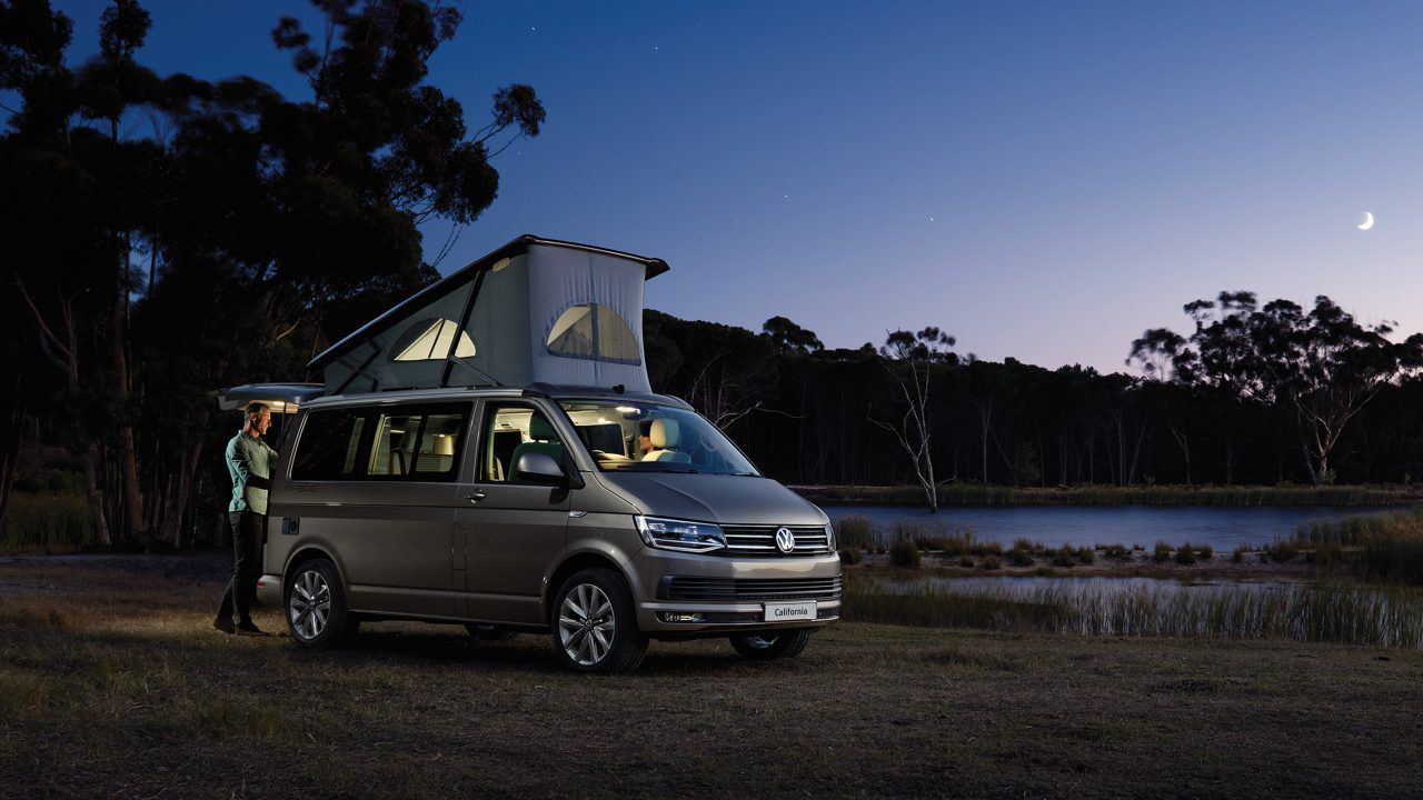Volkswagen California at night parked in a field