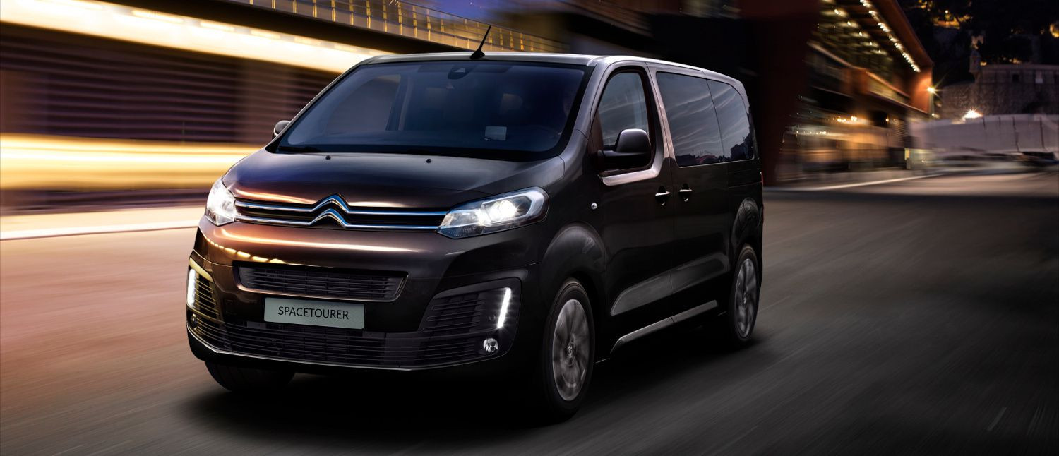 Dark chocolate metallic coloured Citroen SpaceTourer driving towards you