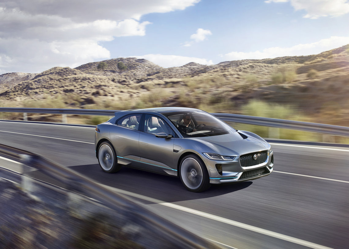 Silver Jaguar I-PACE driving at speed