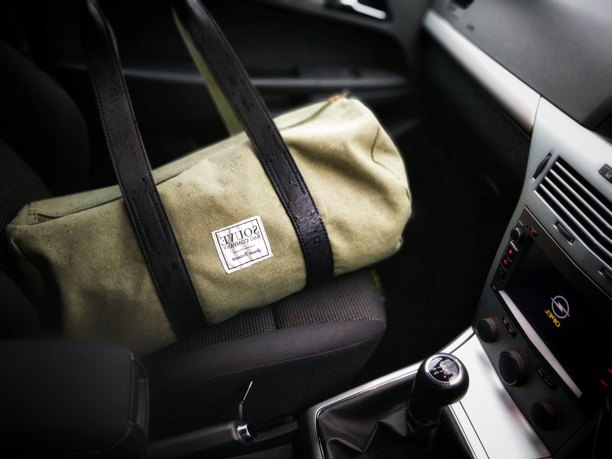 Gym bag on the passenger seat of a car