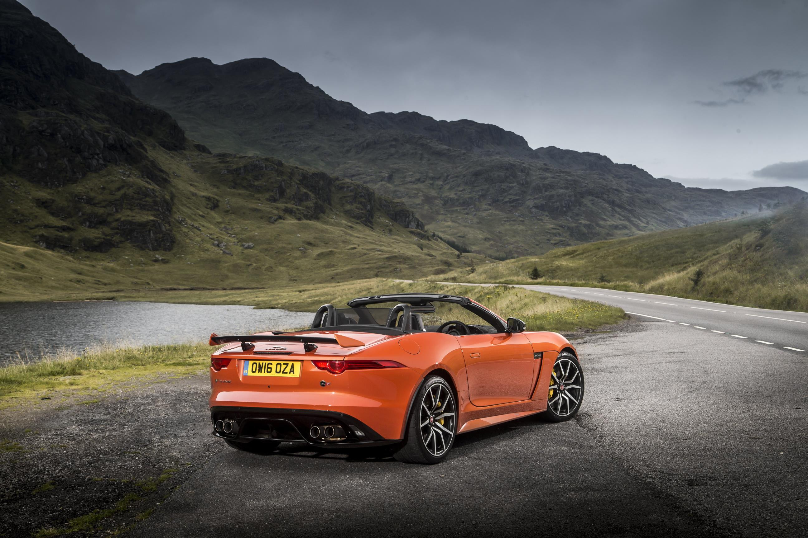 Orange Jaguar F-Type convertible in an amazing background