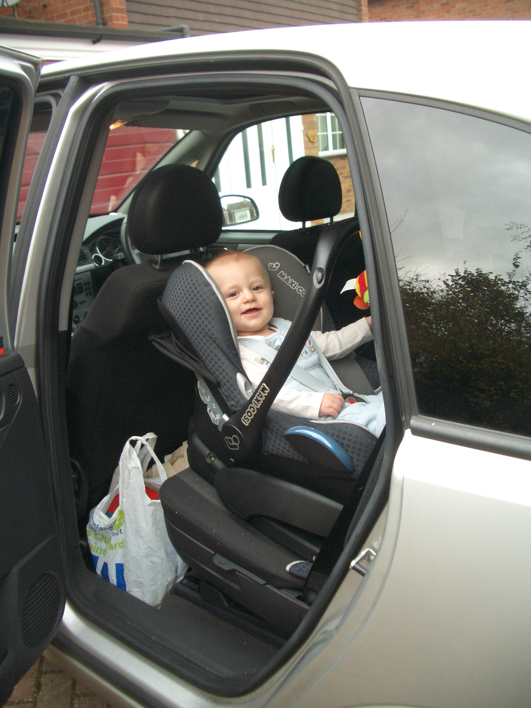 Rear facing baby seat in car with isofix