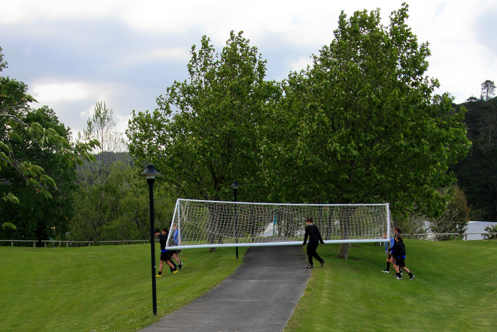Group of people moving goalposts