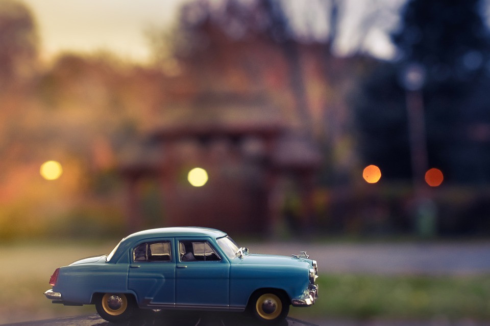 Old toy car with a sunset background
