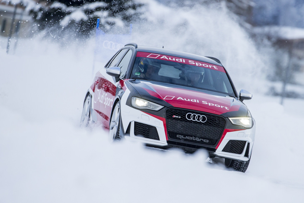 Audi RS quattro rally car driving in deep snow