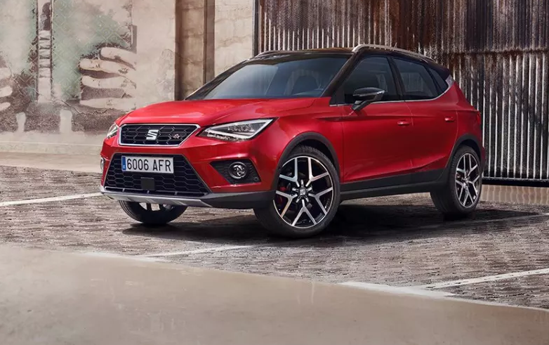 Red SEAT Arona parked two thirds front on cobbled street