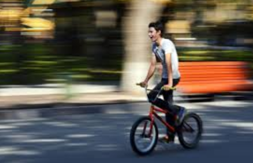 Boy on a bike with blurred background